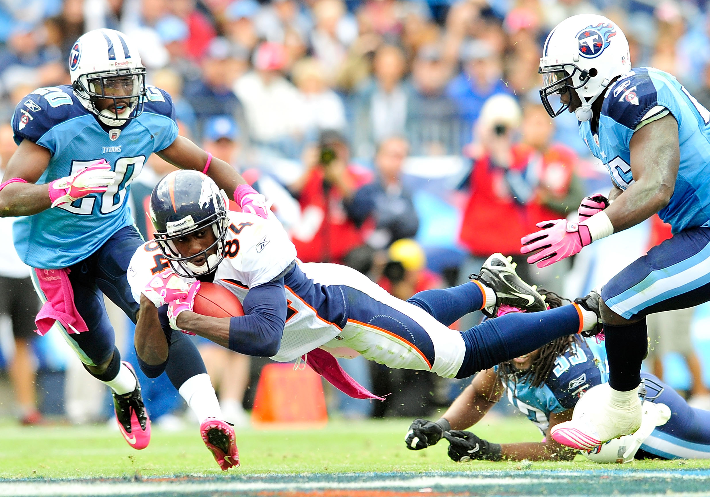 NASHVILLE, TN - OCTOBER 03:  Brandon Lloyd #84  of the Denver Broncos dives for extra yardage against the Tennessee Titans at LP Field on October 3, 2010 in Nashville, Tennessee. Denver won 26-20.  (Photo by Grant Halverson/Getty Images)