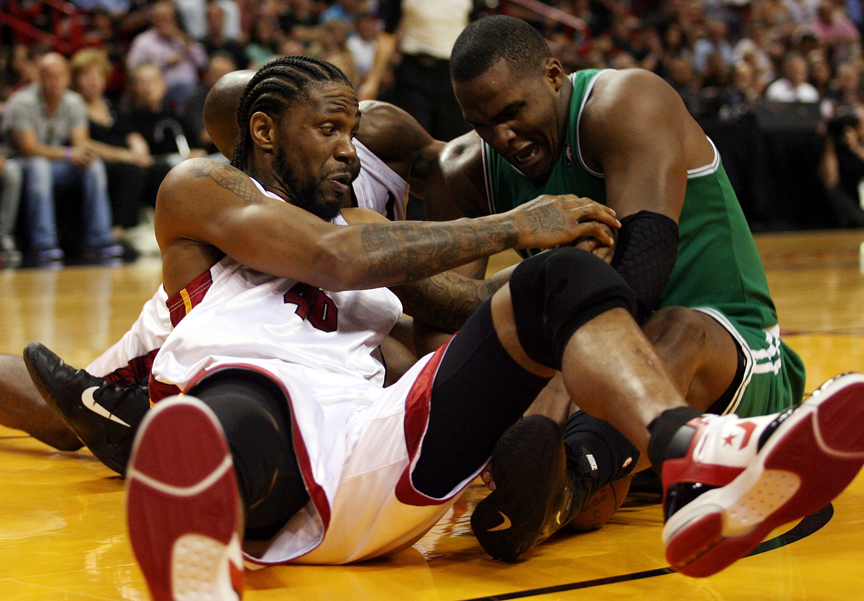 MIAMI - APRIL 25:  Center Glen Davis #11 of the Boston Celtics battles forward Udonis Haslem #40 of  the Miami Heat in Game Four of the Eastern Conference Quarterfinals during the 2010 NBA Playoffs at American Airlines Arena on April 25, 2010 in Miami, Fl