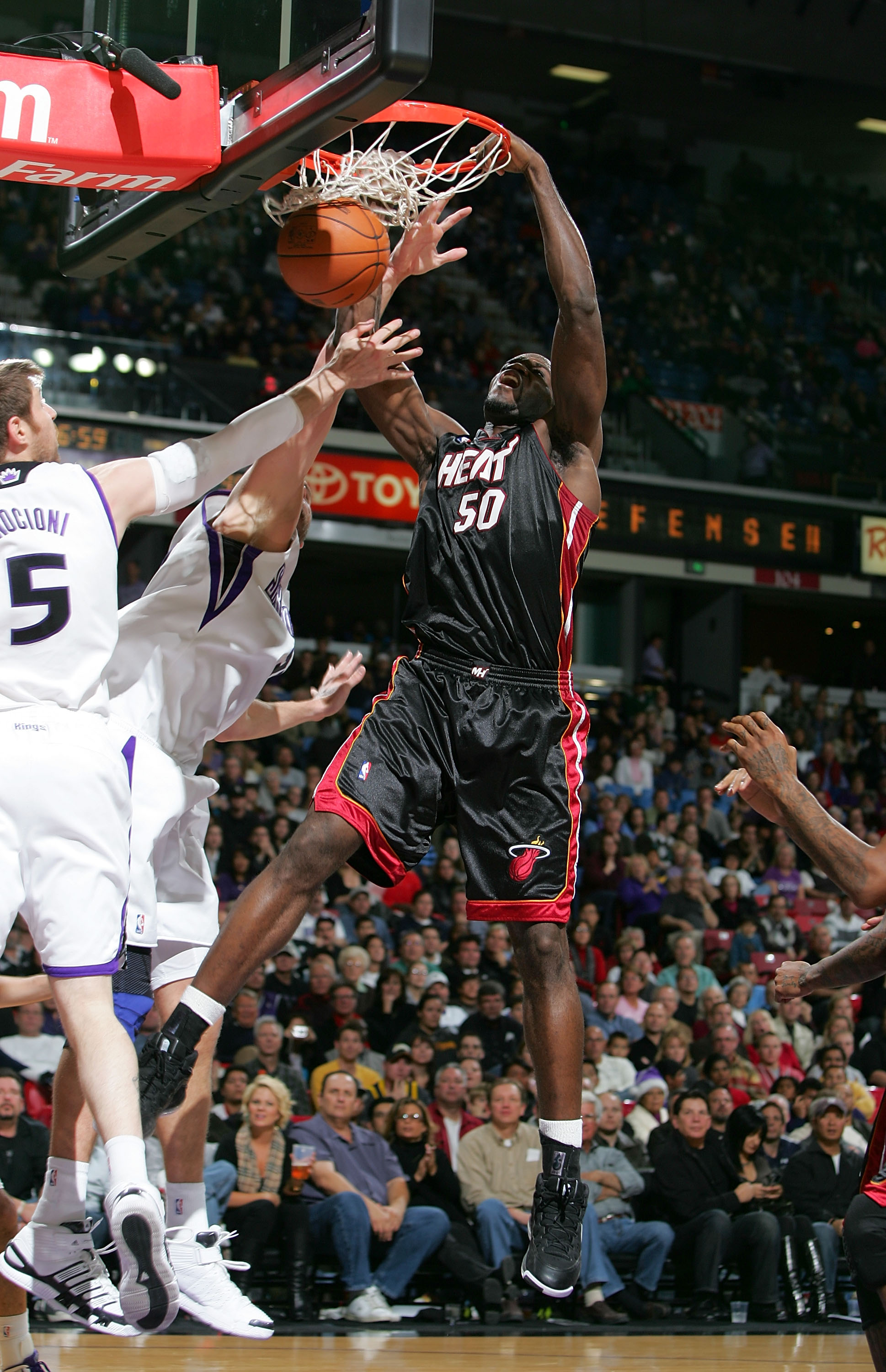 SACRAMENTO, CA - DECEMBER 06:  Joel Anthony #50 of the Miami Heat dunks the ball during their game against the Sacramento Kings at ARCO Arena on December 6, 2009 in Sacramento, California.  NOTE TO USER: User expressly acknowledges and agrees that, by dow