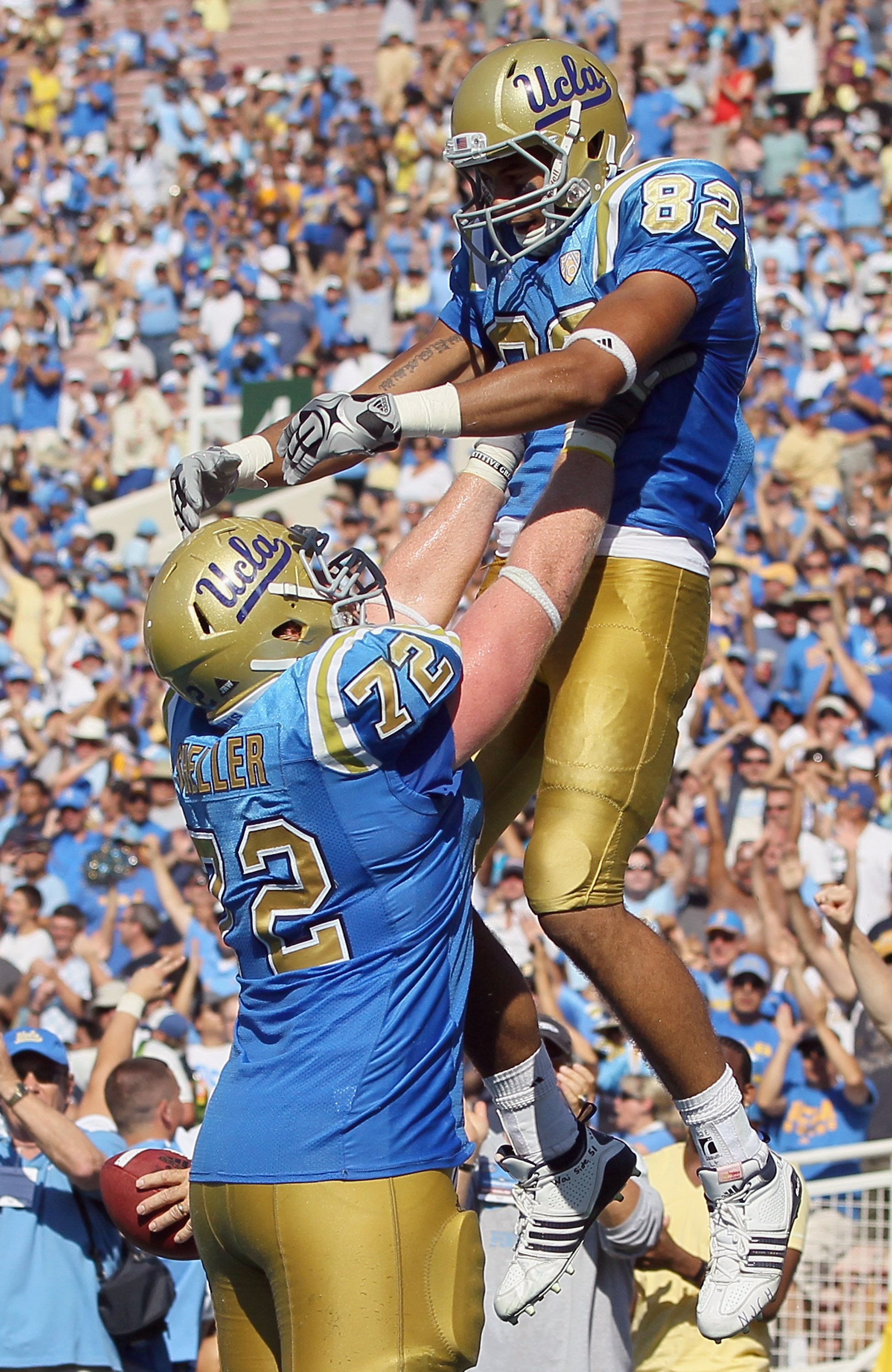PASADENA, CA - OCTOBER 02:  Sean Sheller #72 and  Taylor Embree #82 of the UCLA Bruins celebrate Embree's two-point conversion against the Washington State Cougars during the third quarter at the Rose Bowl on October 2, 2010 in Pasadena, California. UCLA