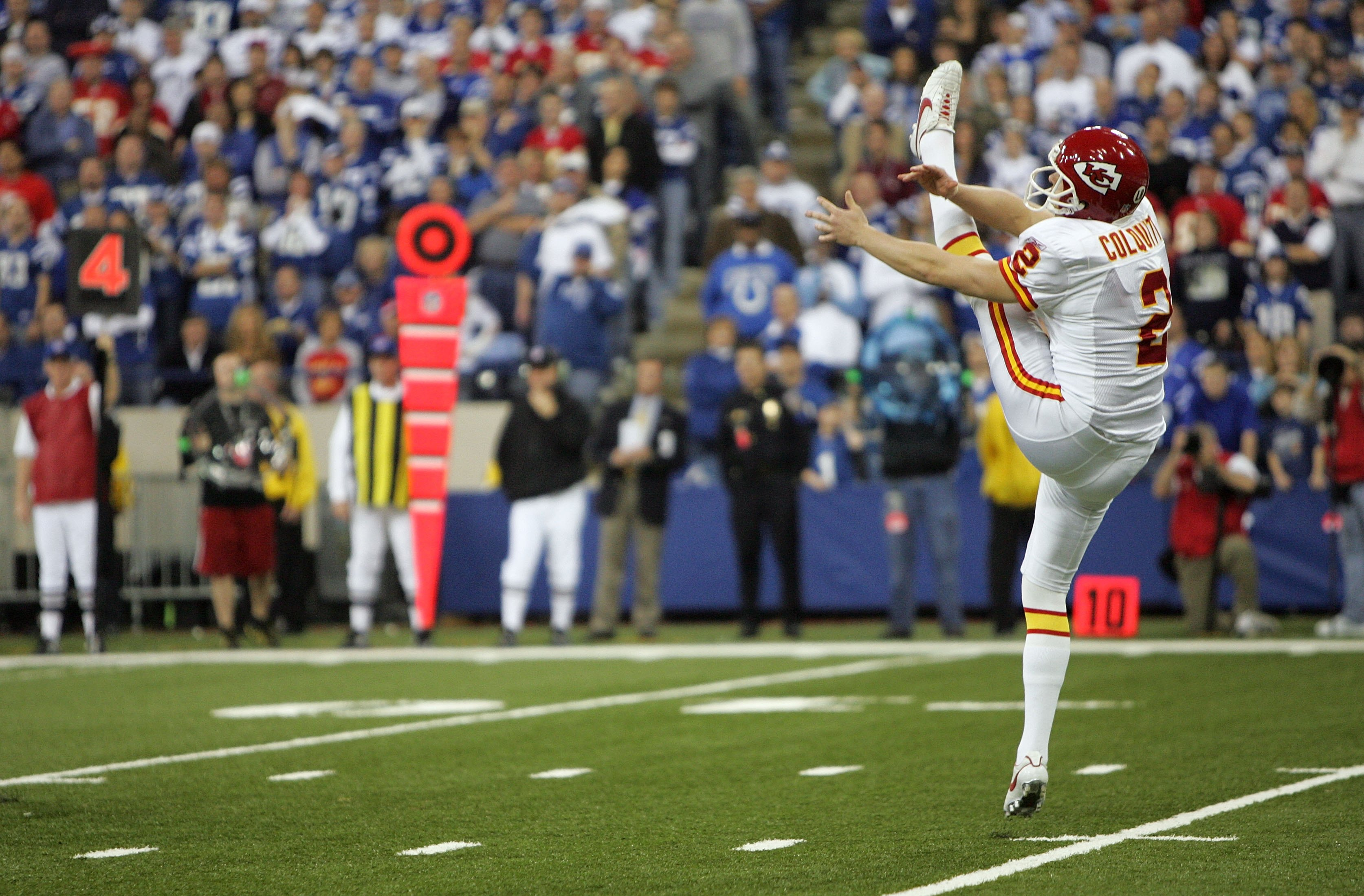 INDIANAPOLIS - JANUARY 06:  Punter Dustin Colquitt #2 of the Kansas City Chiefs follows through on a punt against the Indianapolis Colts during their AFC Wild Card Playoff Game January 6, 2007 at RCA Dome in Indianapolis, Indiana. The Colts won 23-8.  (Ph