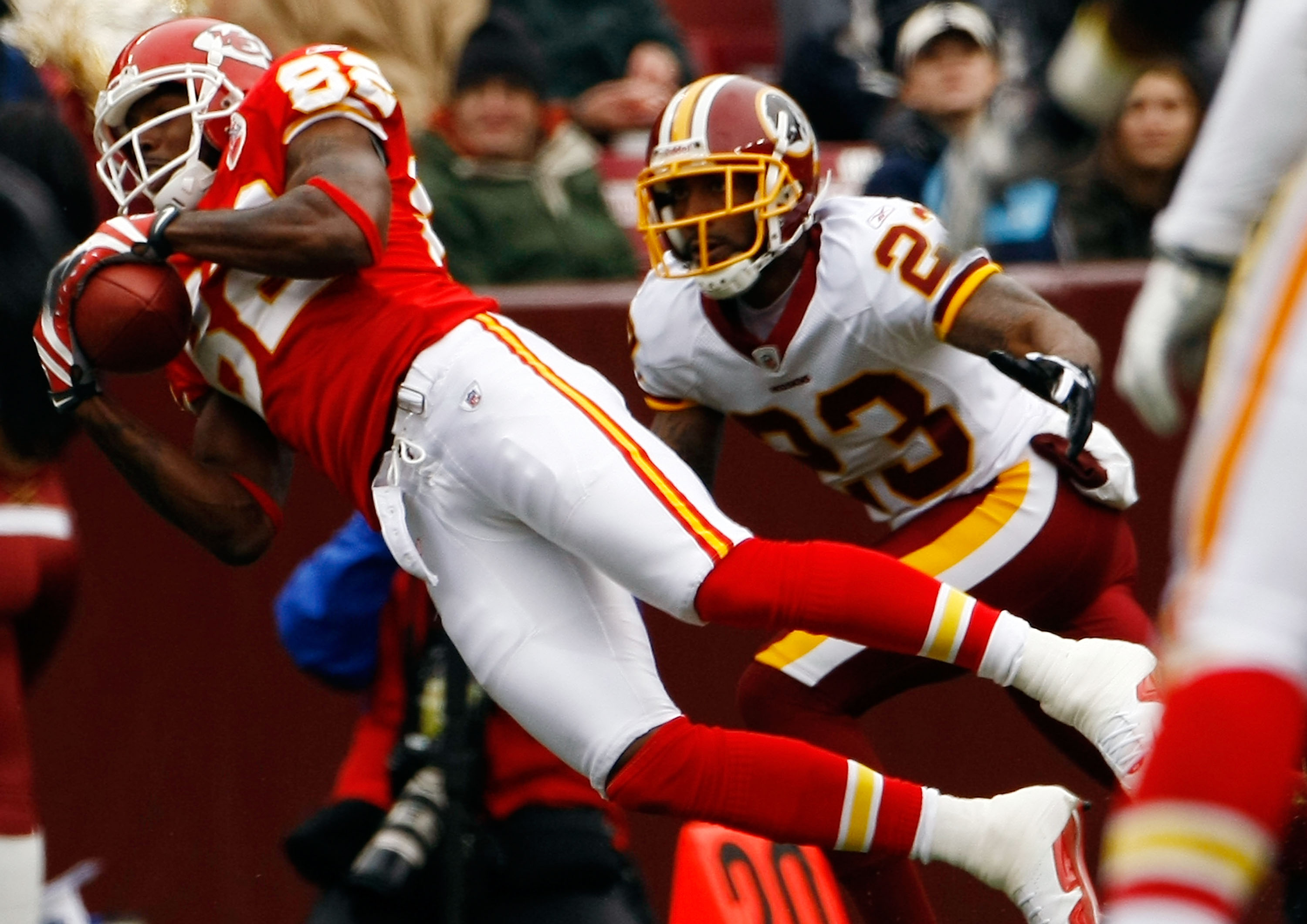 LANDOVER, MD - OCTOBER 18:  Dwayne Bowe #82 of the Kansas City Chiefs catches a pass as DeAngelo Hall #23 of the Washington Redskins defends during their game October 18, 2009 at FedEx Field in Landover, Maryland.The Chiefs won the game 14-6.  (Photo by W