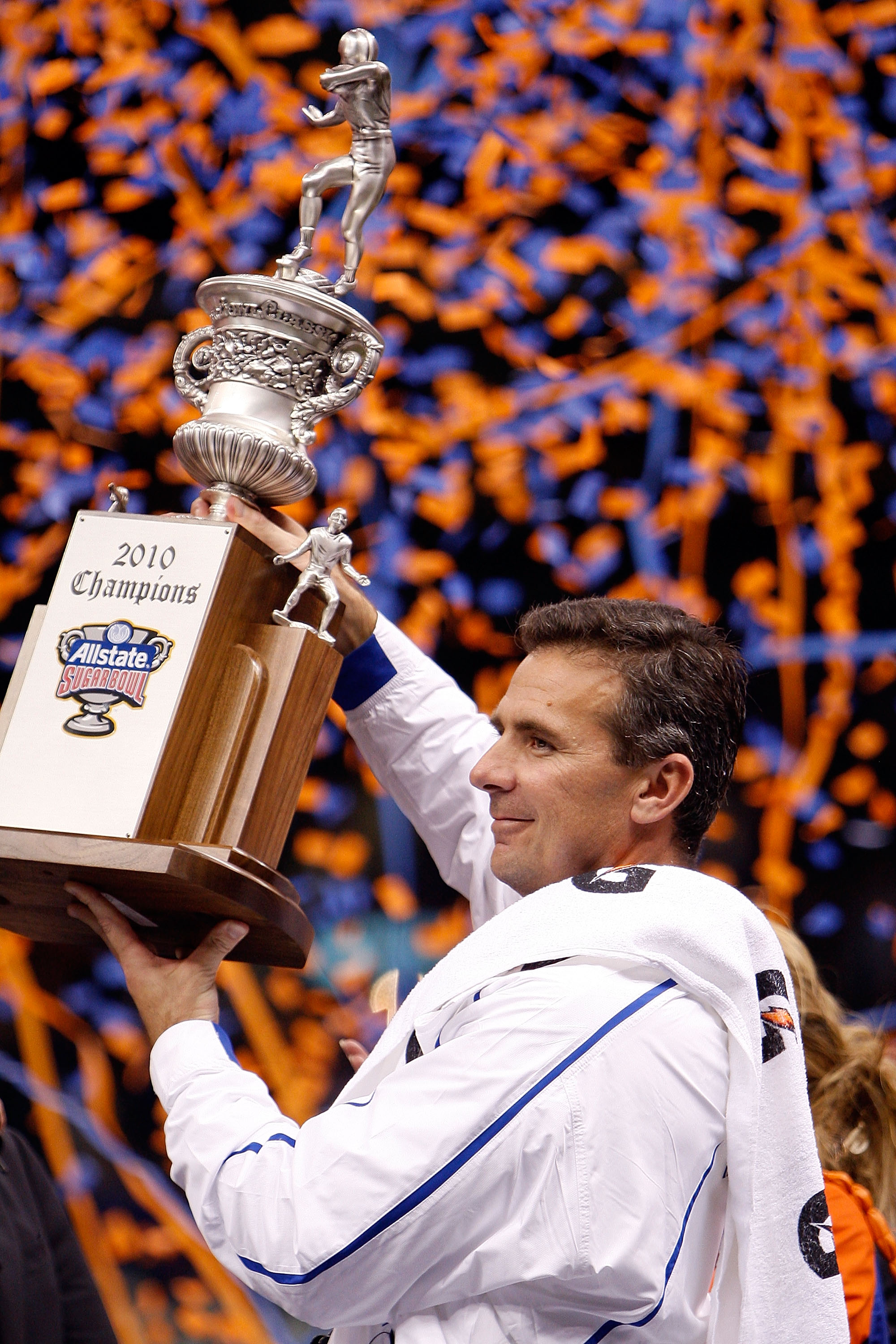 NEW ORLEANS - JANUARY 01:  Head coach Urban Meyer of the Florida Gators hoist the trophy after the Gators defeated the Bearcats 24-51 in the Allstate Sugar Bowl at the Louisana Superdome on January 1, 2010 in New Orleans, Louisiana.  (Photo by Chris Grayt