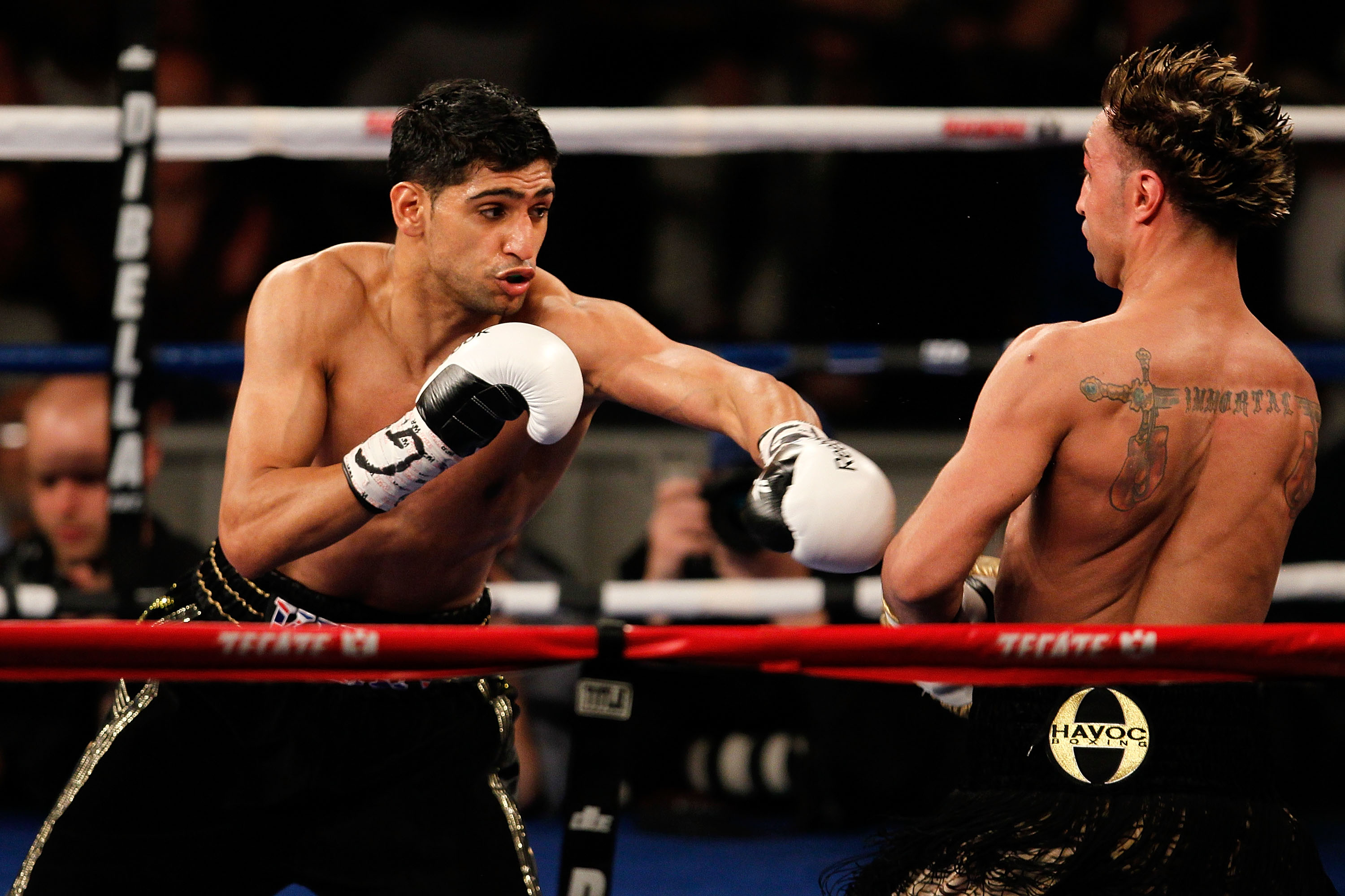 NEW YORK - MAY 15:  Amir Khan (L) of Great Britain hits Paulie Malignaggi during the WBA light welterweight title fight at Madison Square Garden on May 15, 2010 in New York City.  (Photo by Chris Trotman/Getty Images)
