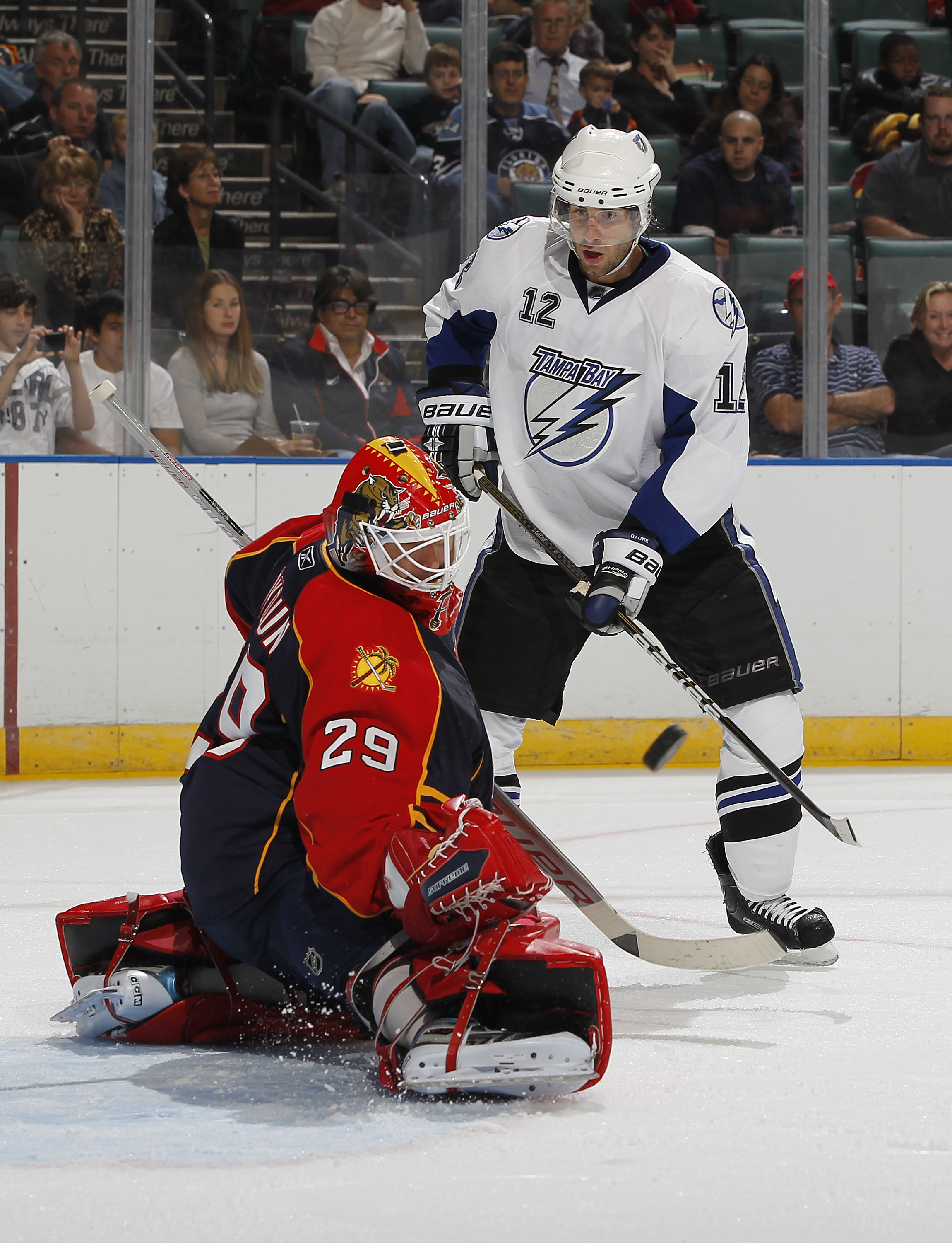 SUNRISE, FL - OCTOBER 1: Goaltender Tomas Vokoun #29 of the Florida Panthers stops a shot from Simon Gagne #12 of the Tampa Bay Lightning during a preseason game on October 1, 2010 at the BankAtlantic Center in Sunrise, Florida. (Photo by Joel Auerbach/Ge