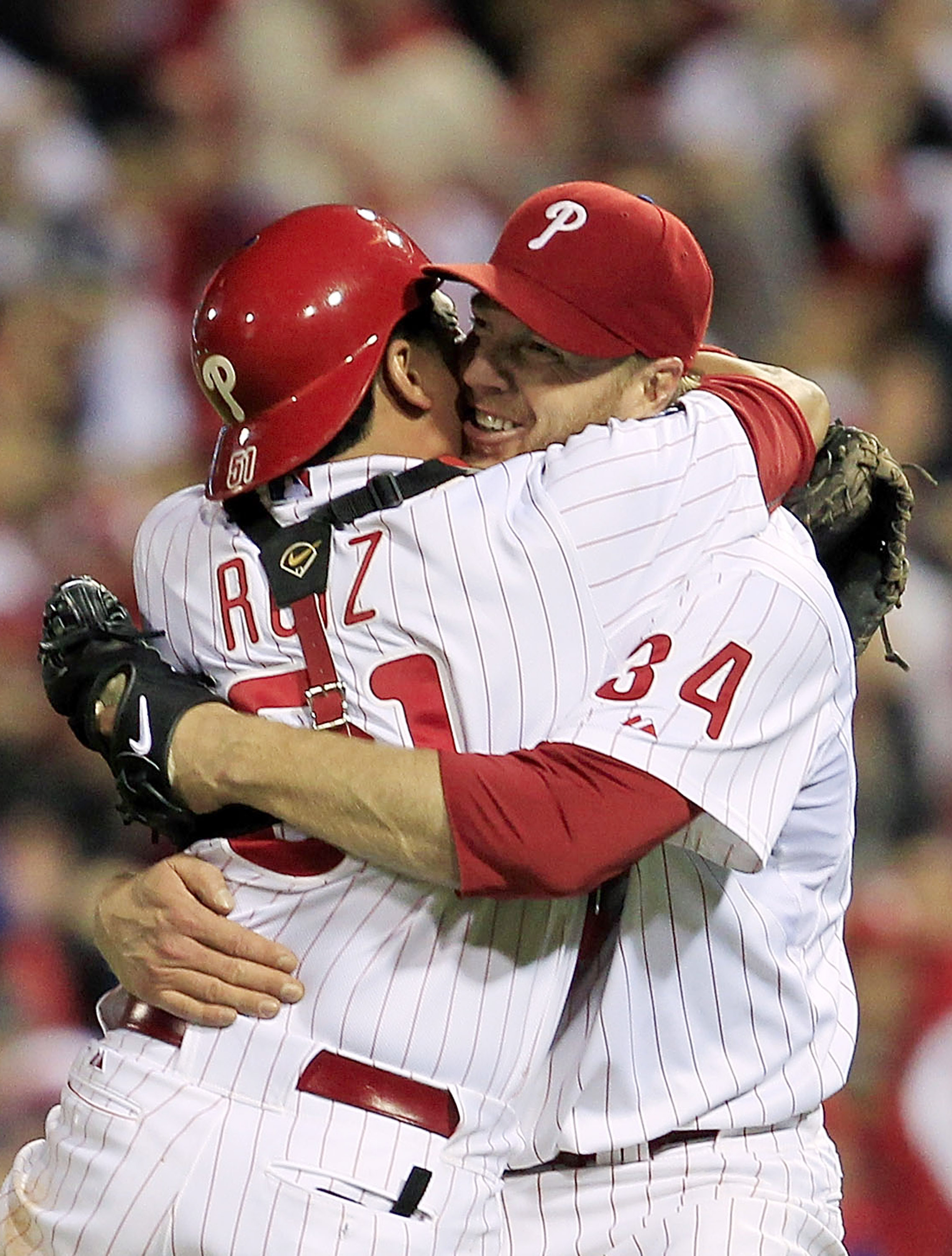 PHILADELPHIA - OCTOBER 06: (EDITORS NOTE: Alternate Crop) Roy Halladay #34 and Carlos Ruiz #51 of the Philadelphia Phillies celebrate Halladay's no-hitter and the win in Game 1 of the NLDS against the Cincinnati Reds at Citizens Bank Park on October 6, 20