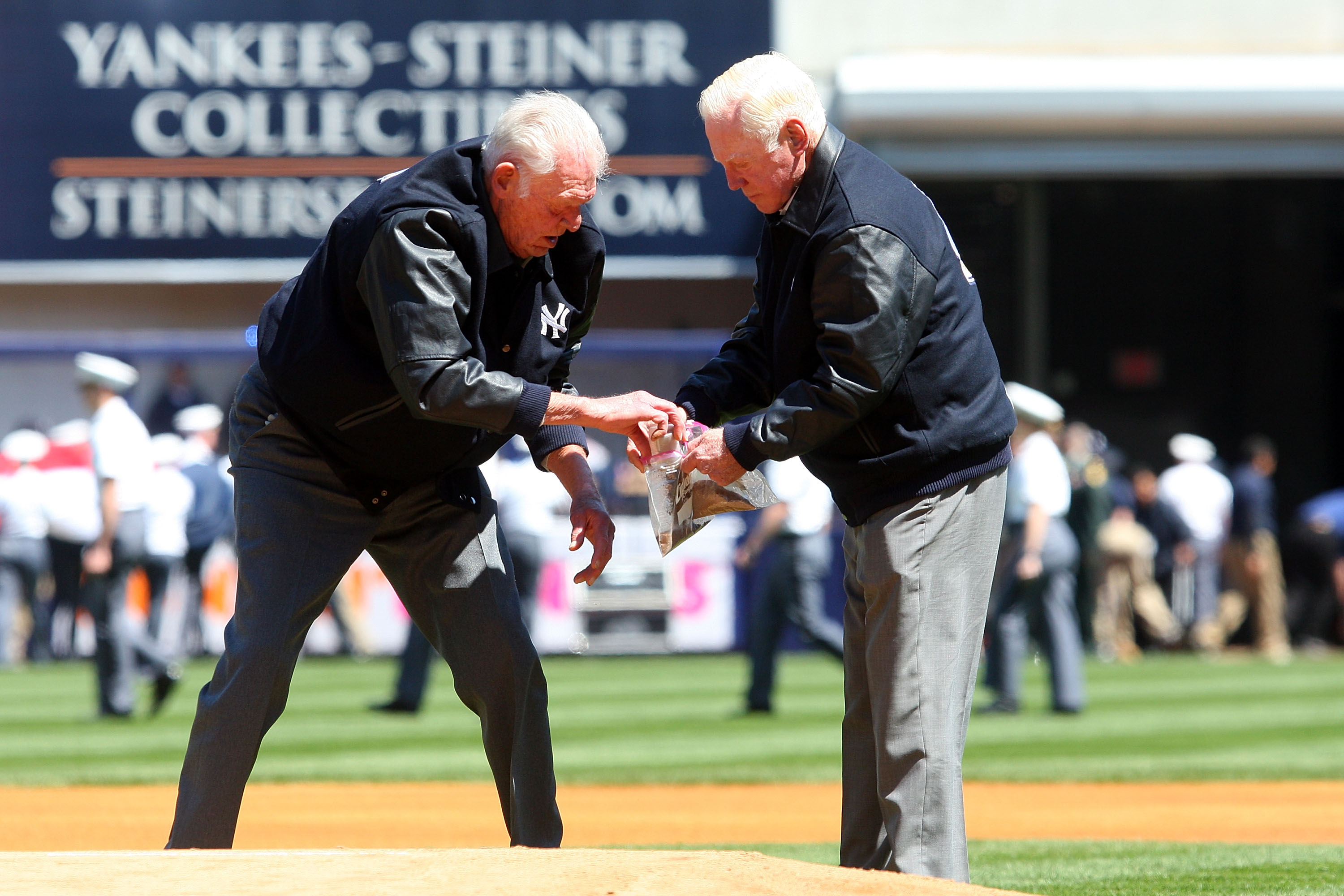 NEW YORK - APRIL 16:  Former New York Yankees Don Larsen and Whitey Ford take dirt from the pitchers mound during an opening day ceremony at the new Yankee Stadium on April 16, 2009 in the Bronx borough of New York City. This is the first regular season M