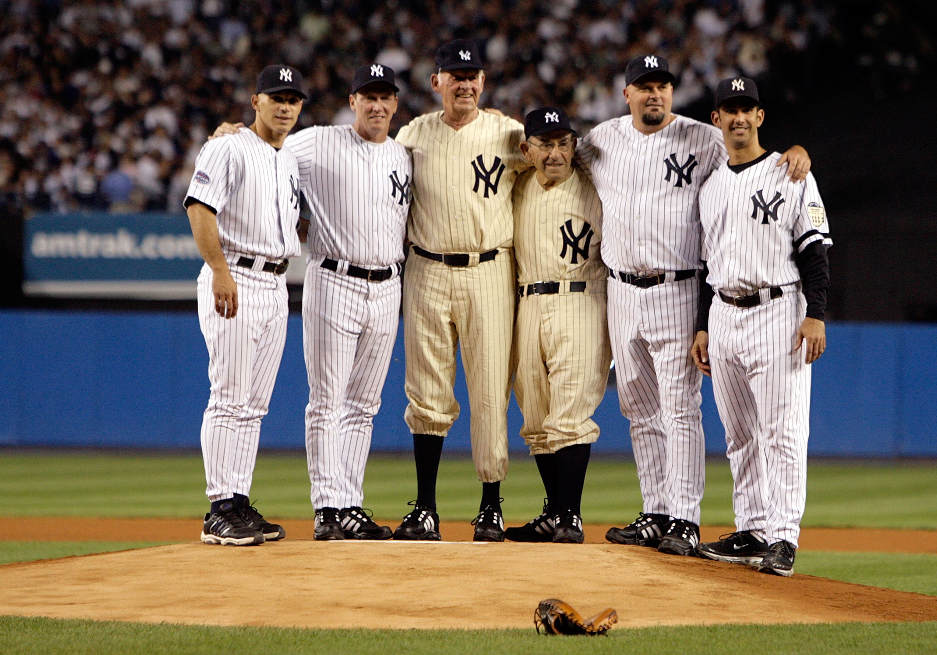 NEW YORK - SEPTEMBER 21:  (L-R) Joe Girardi, David Cone, Don Larsen, Yogi Berra, David Wells and Jorge Posada stand on the mound during a pregame ceremony prior to the start of the last regular season game at Yankee Stadium between the Baltimore Orioles a