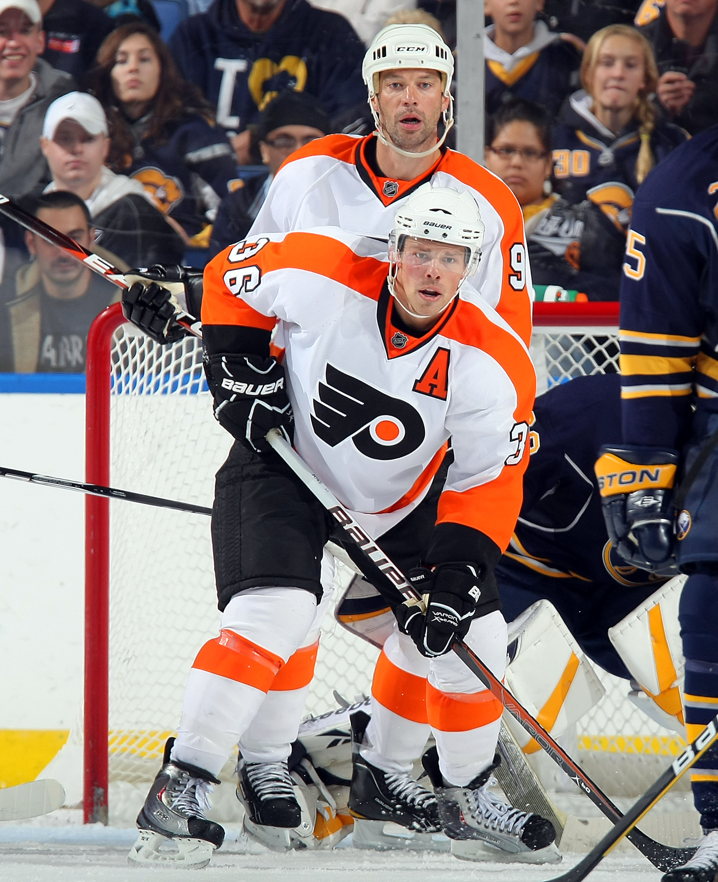 BUFFALO - OCTOBER 3:  Bill Guerin #9 and Darroll Powe #36 both of the Philadelphia Flyers set up in front of the Buffalo Sabres net during their NHL game at HSBC Arena October 3, 2010 in Buffalo, New York. The Sabres won 9-3. (Photo By Dave Sandford/Getty