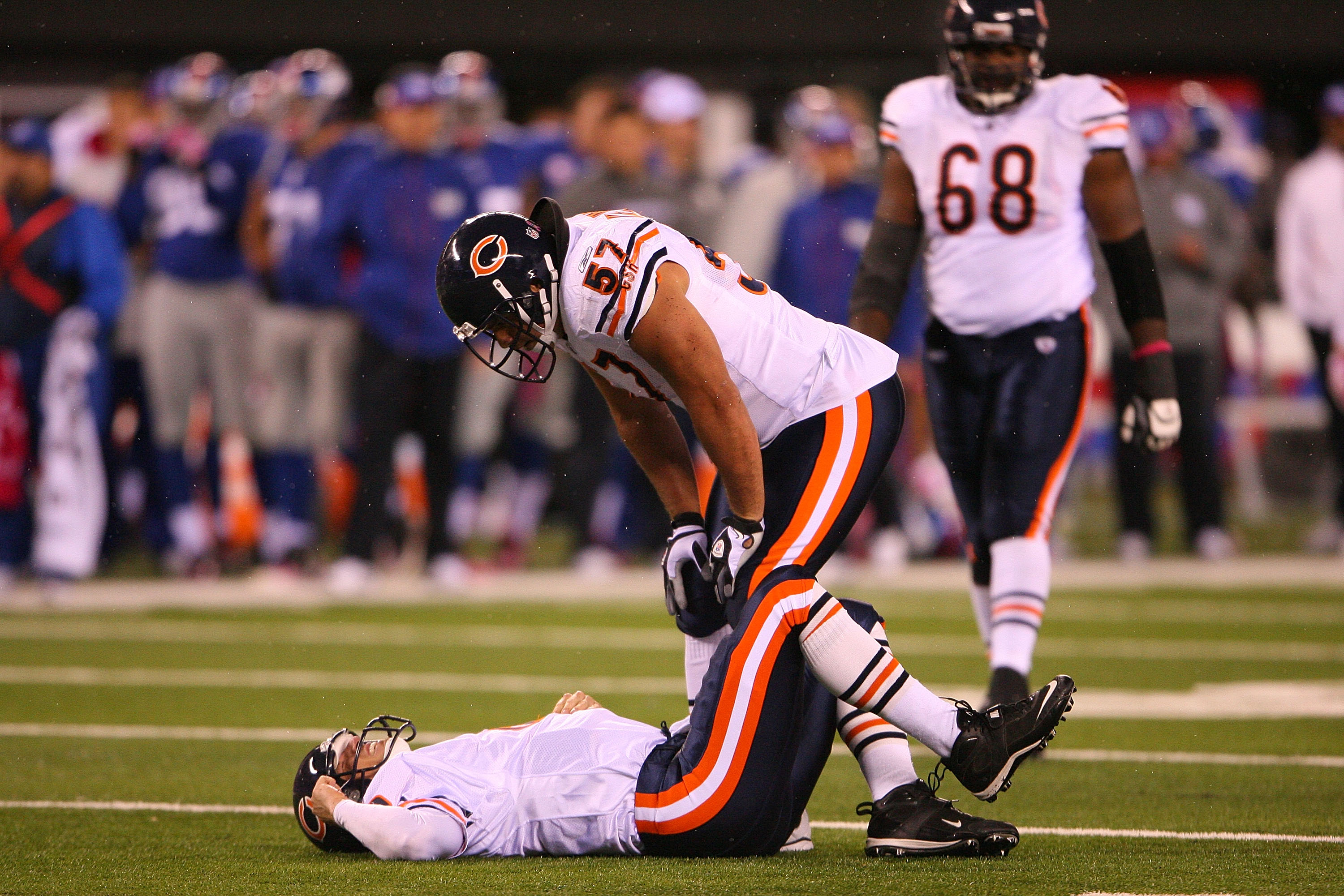 EAST RUTHERFORD, NJ - OCTOBER 03:  Olin Kreutz #57 looks at Todd Collins #10 of the Chicago Bears as he lays on the field after getting injured against the New York Giants at New Meadowlands Stadium on October 3, 2010 in East Rutherford, New Jersey.  (Pho