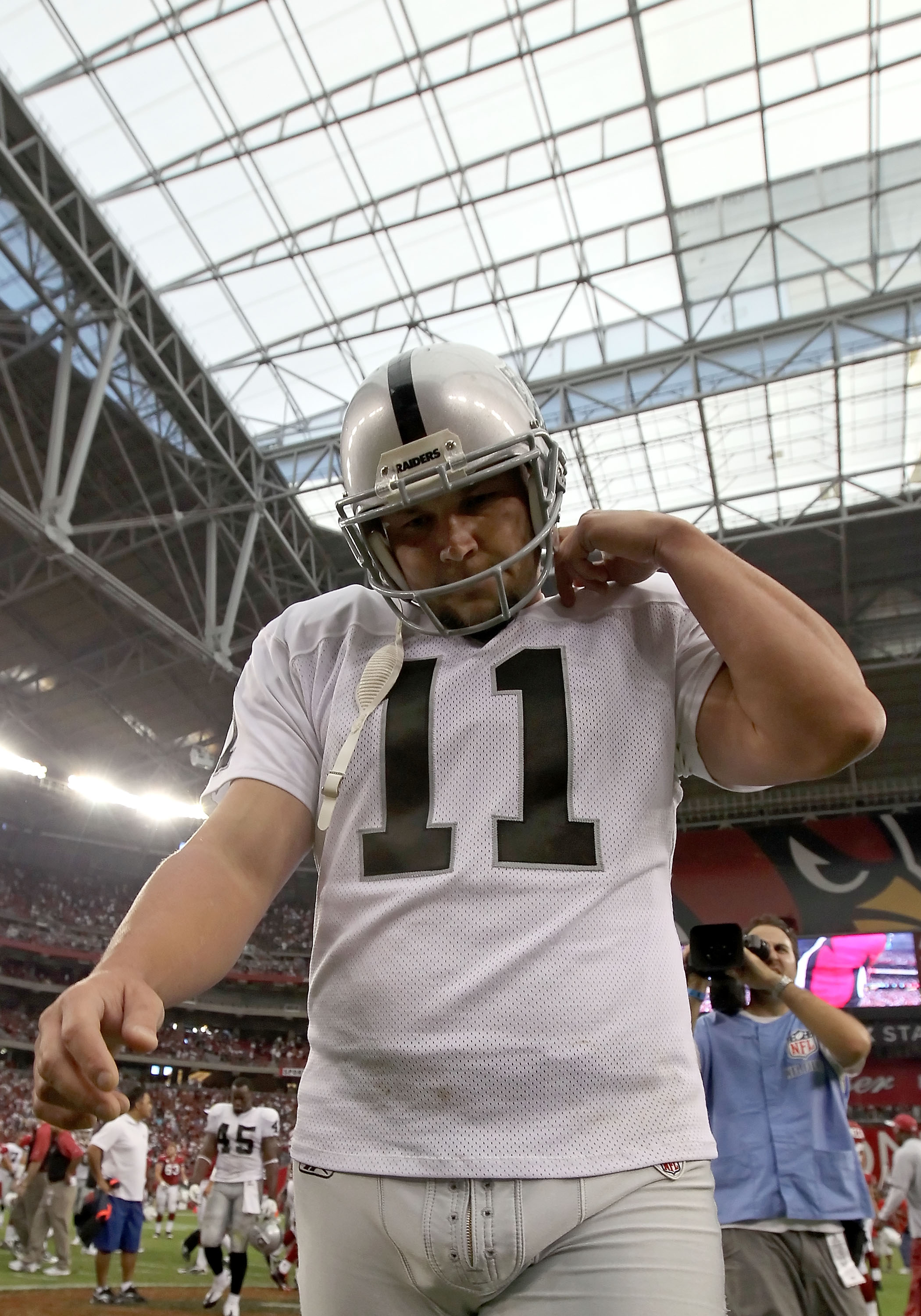GLENDALE, AZ - SEPTEMBER 26:  Kicker Sebastian Janikowski #11 of the Oakland Raiders walks off the field after missing the game winning 32 yard field goal against the Arizona Cardinals during the NFL game at the University of Phoenix Stadium on September