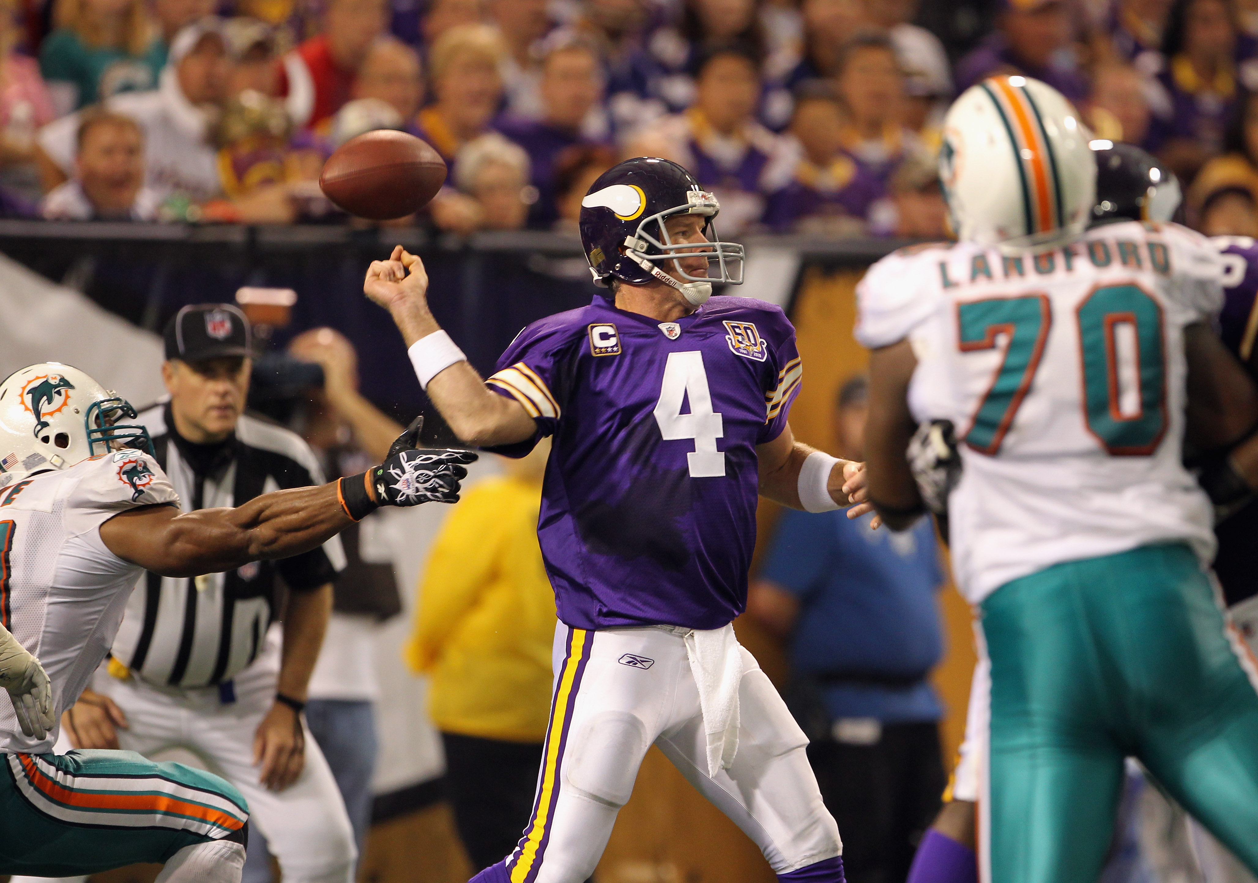MINNEAPOLIS - SEPTEMBER 19:  Linebacker Cameron Wake #91 of the Miami Dolphins forces the ball loose as quarterback Brett Favre #4 of the Minnesota Vikings drops back to pass during the game on September 19, 2010 at Hubert H. Humphrey Metrodome in Minneap