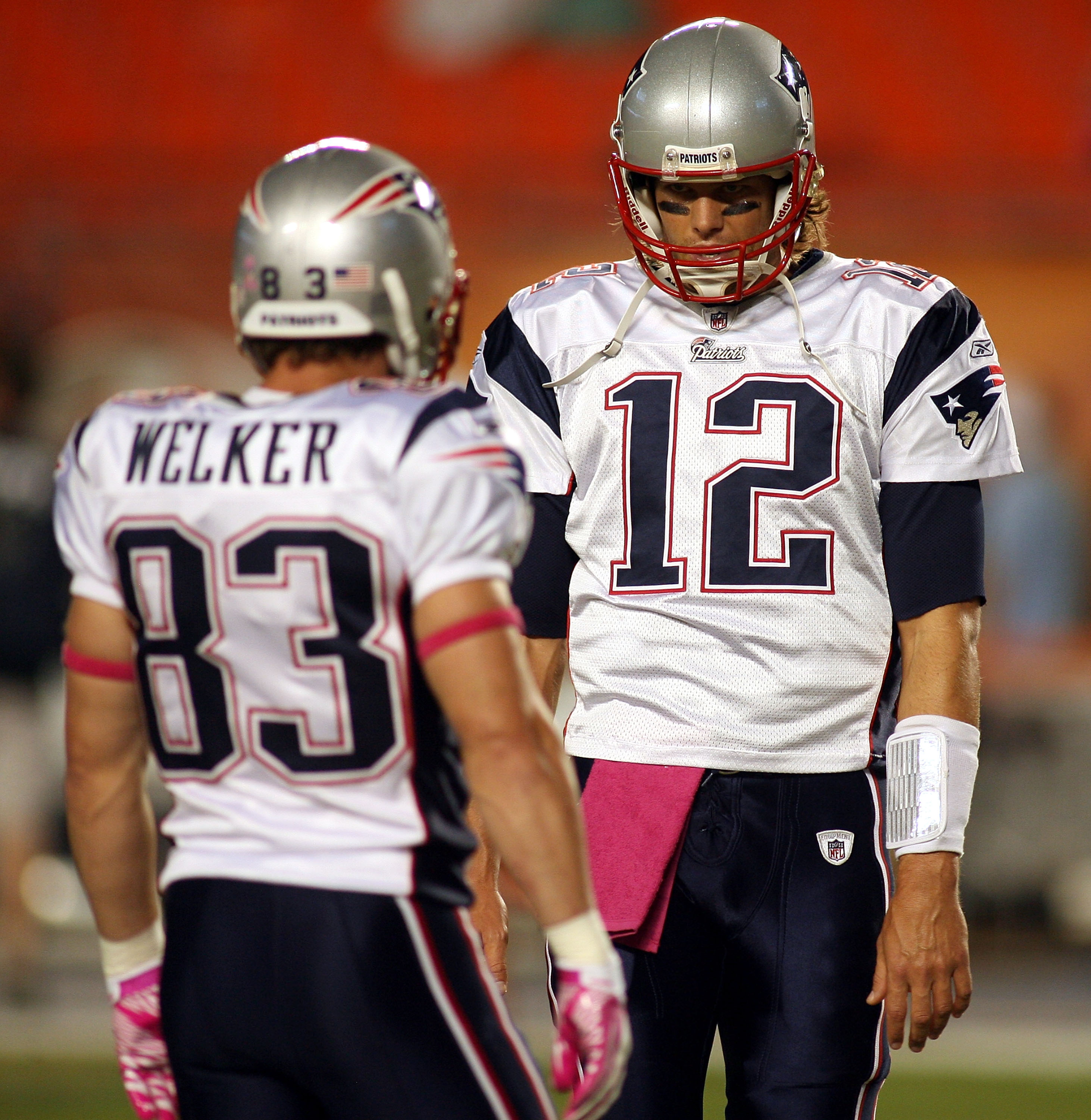 MIAMI - OCTOBER 04:  Quarterback Tom Brady #12 of the New England Patriots with Reciever Wes Welker #83 during warm ups against the Miami Dolphins at Sun Life Stadium on October 4, 2010 in Miami, Florida.  (Photo by Marc Serota/Getty Images)