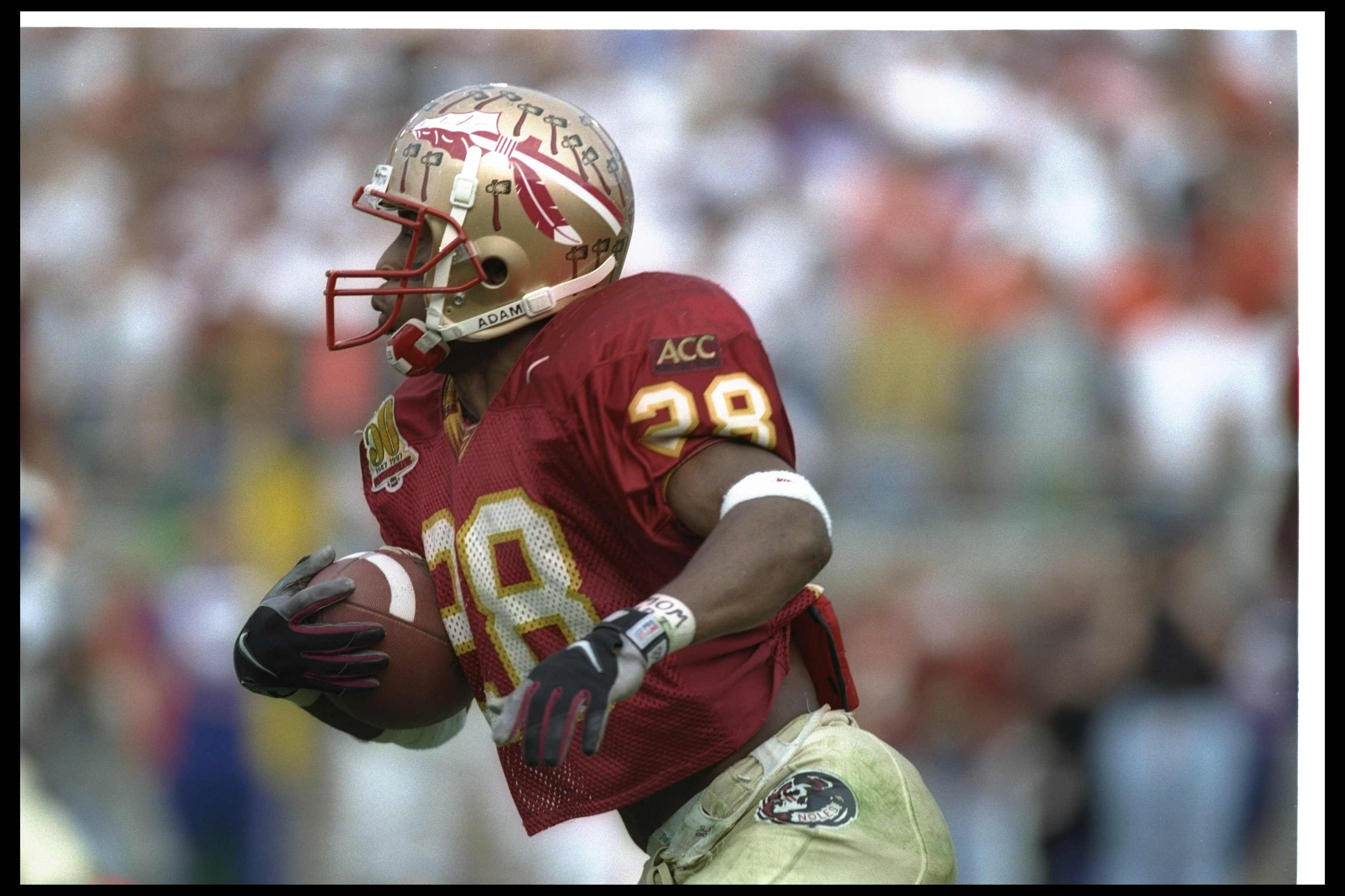 30 Nov 1996:  Running back Warrick Dunn of the Florida State Seminoles runs with the ball during a game against the Florida Gators at Doak S. Campbell Stadium in Tallahassee, Florida.  Florida State won the game, 24-21. Mandatory Credit: Andy Lyons/Allspo