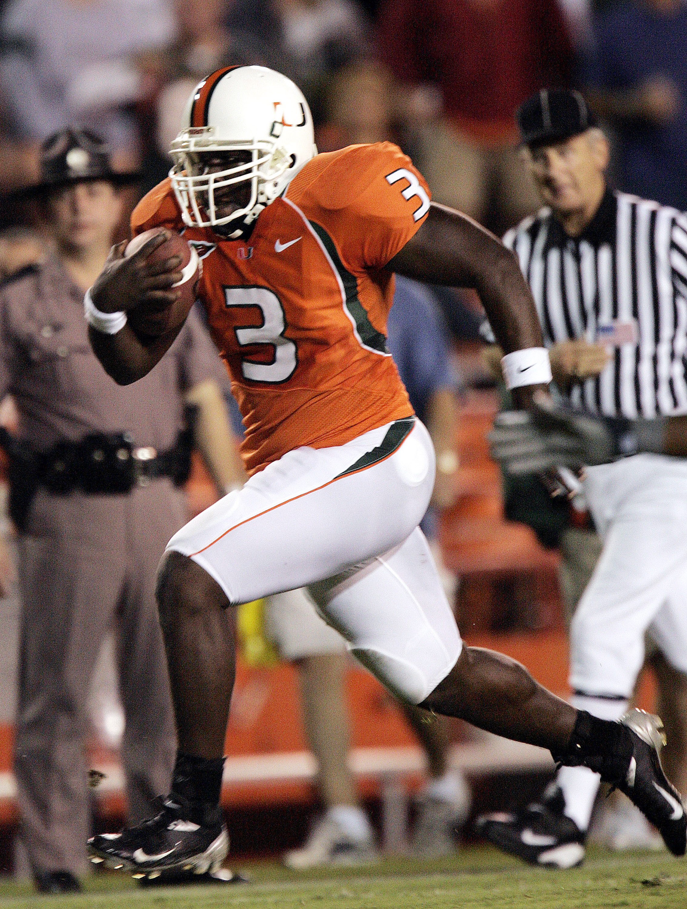 MIAMI - NOVEMBER 6: Running back Frank Gore #3 of the Miami Hurricanes heads into the end zone for a touchdown against the Clemson Tigers in the first half on November 6, 2004 at the Orange Bowl in Miami, Florida. (Photo by Eliot J. Schechter/Getty Images