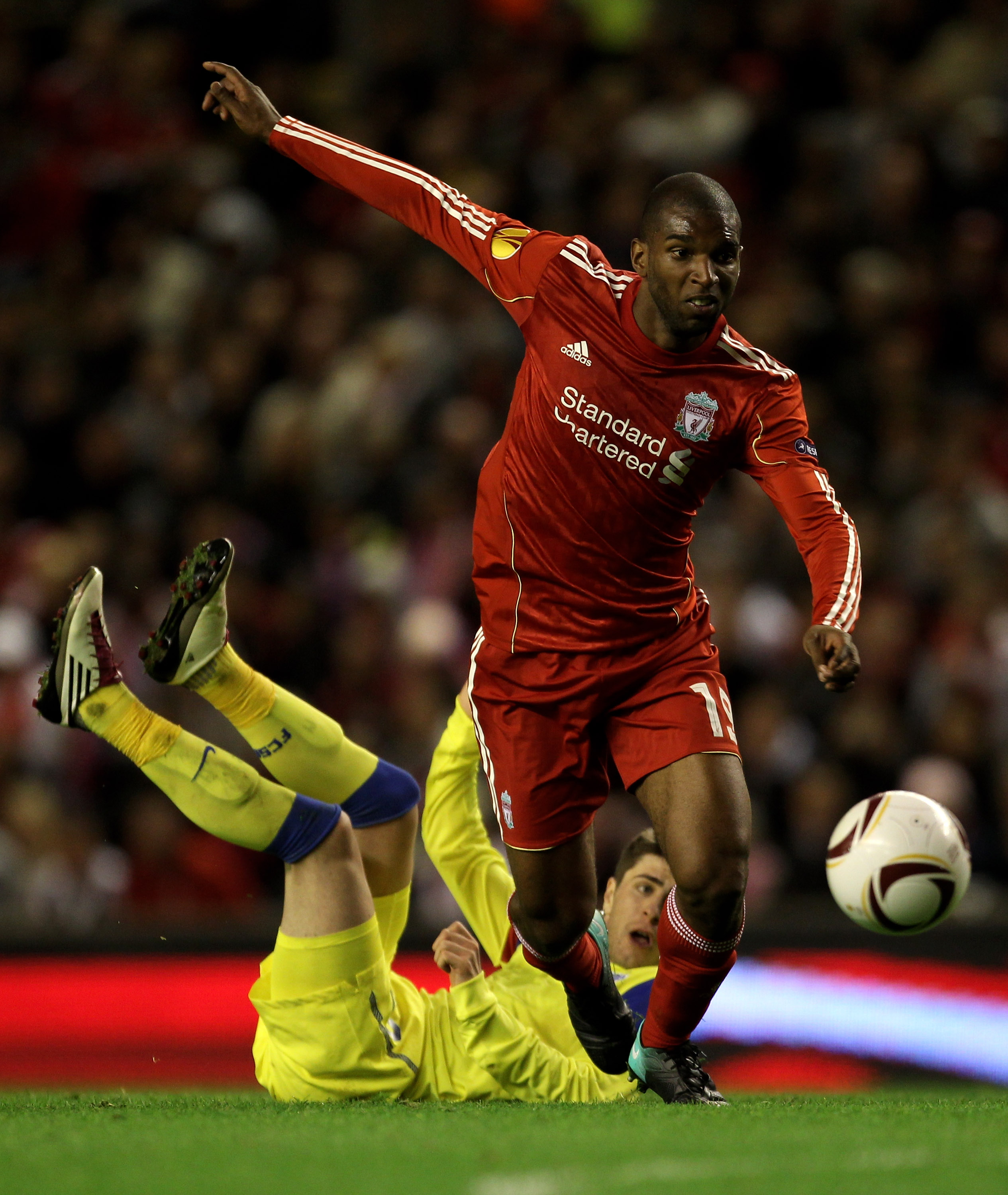 LIVERPOOL, ENGLAND - SEPTEMBER 16 :  Ryan Babel of Liverpool goes past Mihai Radut of Steaua Bucharest during the UEFA Europa League Group K match beteween Liverpool and Steaua Bucharest at Anfield on September 16, 2010 in Liverpool, England.  (Photo by A