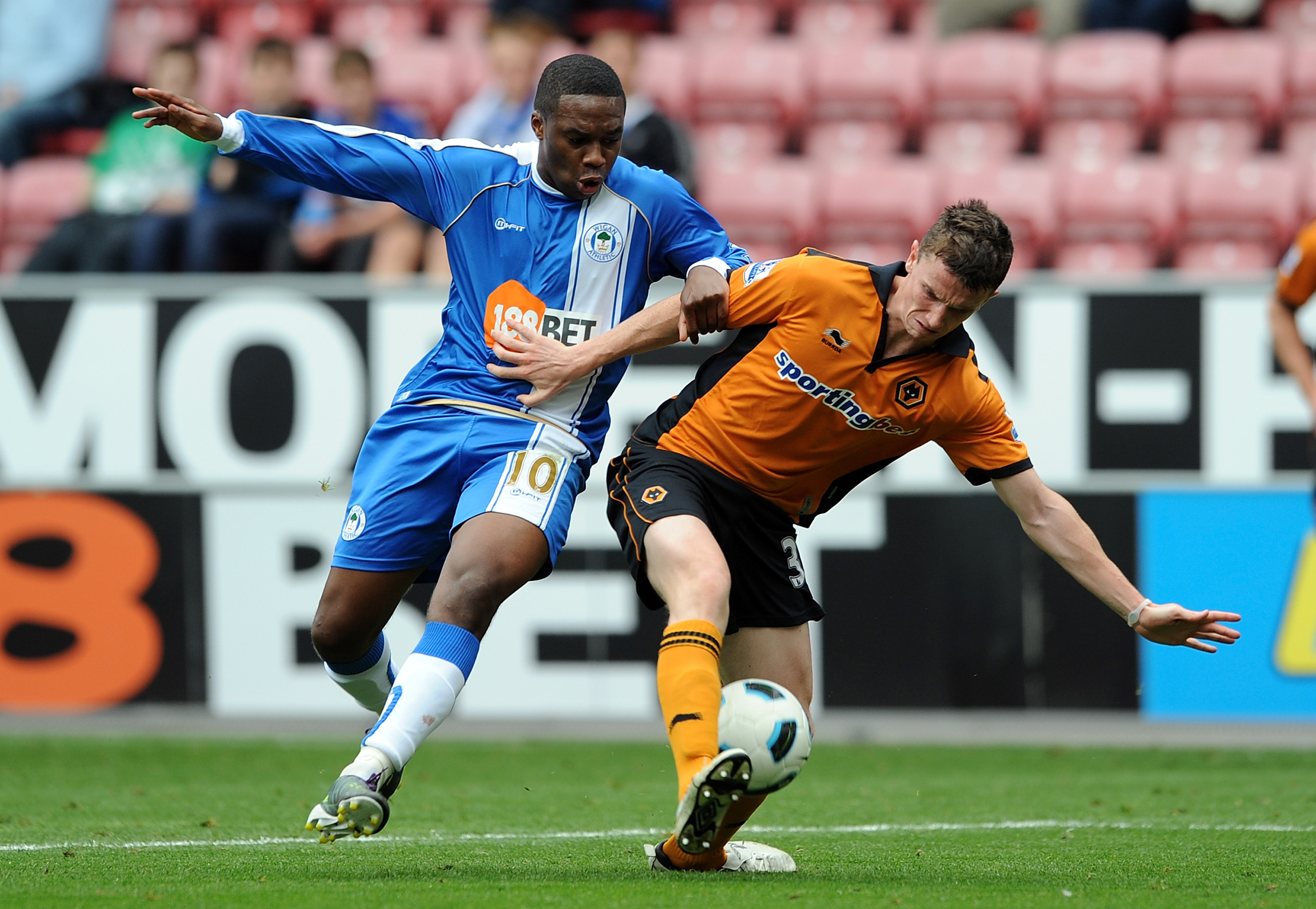 WIGAN, ENGLAND - OCTOBER 02: Charles N'Zogbia of Wigan Athletic competes with Kevin Foley of Wolverhampton Wanderers during the Barclays Premier League match between Wigan Athletic and Wolverhampton Wanderers at DW Stadium on October 2, 2010 in Wigan, Eng