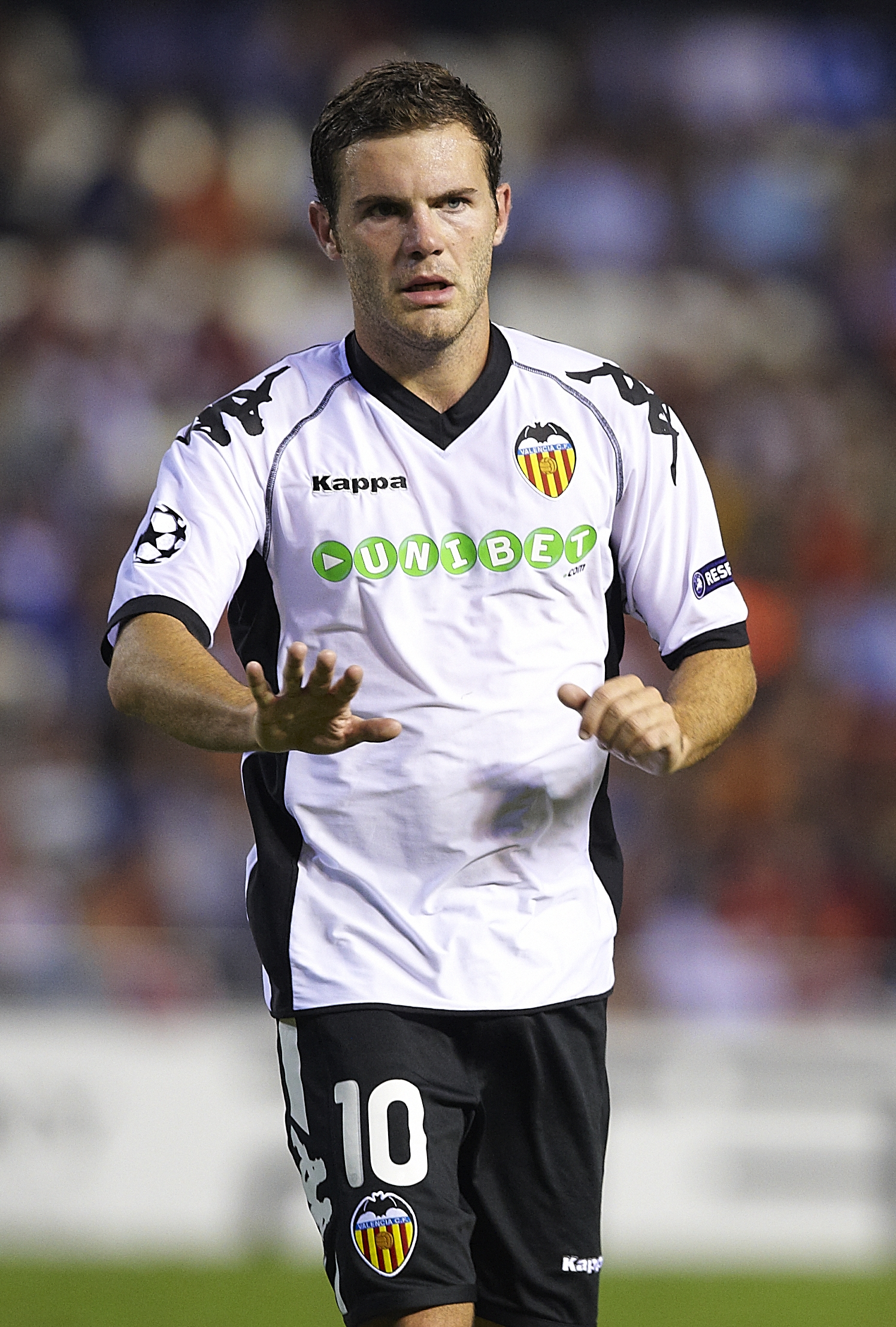 VALENCIA, SPAIN - SEPTEMBER 29:  Juan Mata of Valencia reacts during the UEFA Champions League group C match between Valencia and Manchester United on September 29, 2010 in Valencia, Spain. Manchester United won 1-0.  (Photo by Manuel Queimadelos Alonso/G