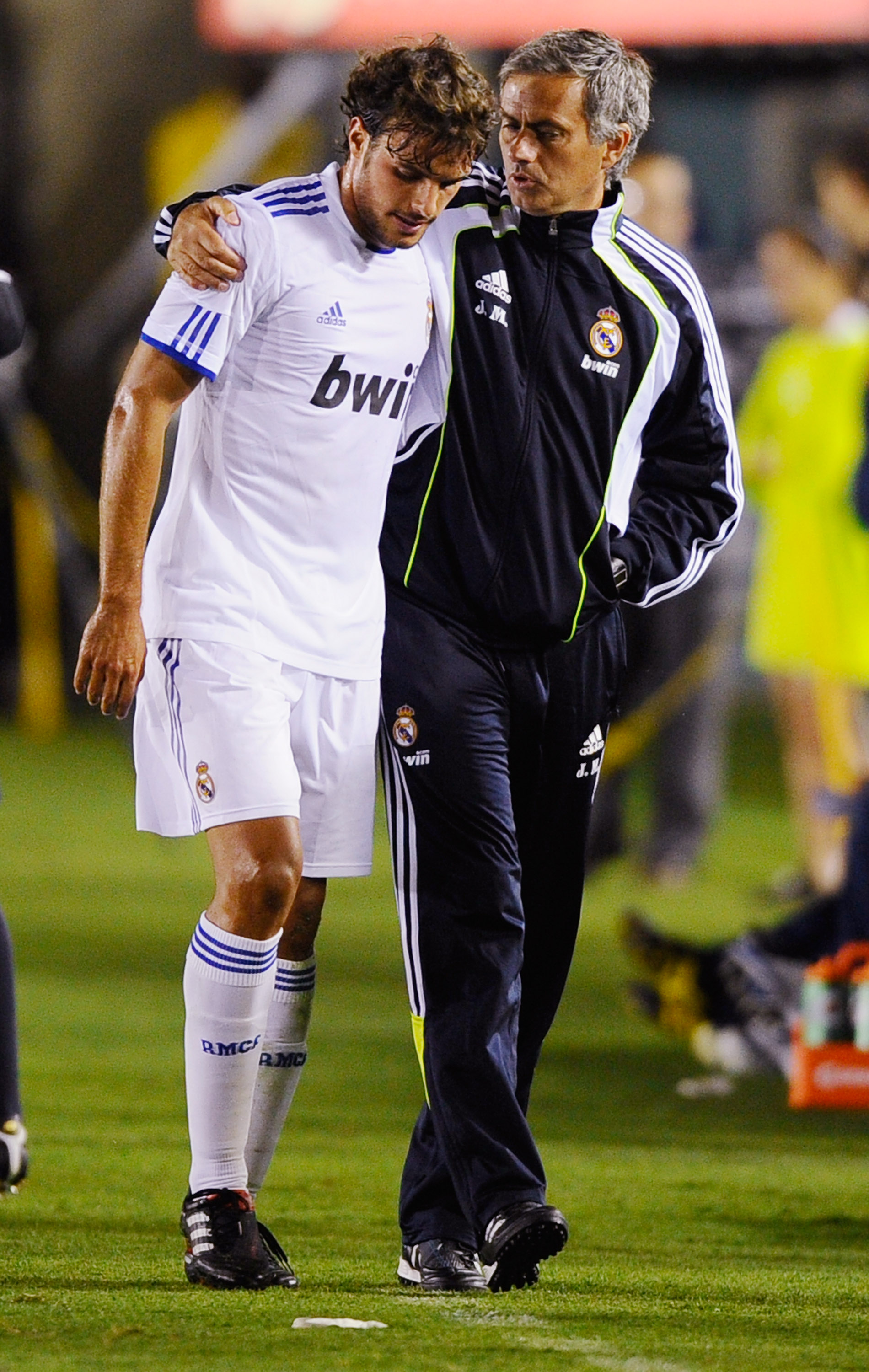 PASADENA, CA - AUGUST 07: Pedro Leon of Real Madrid with coach Jose Mourinho  during their pre-season friendly soccer match against Los Angeles Galaxy on August 7, 2010 at the Rose Bowl in Pasadena, California. Real Madrid will travel back to Spain after