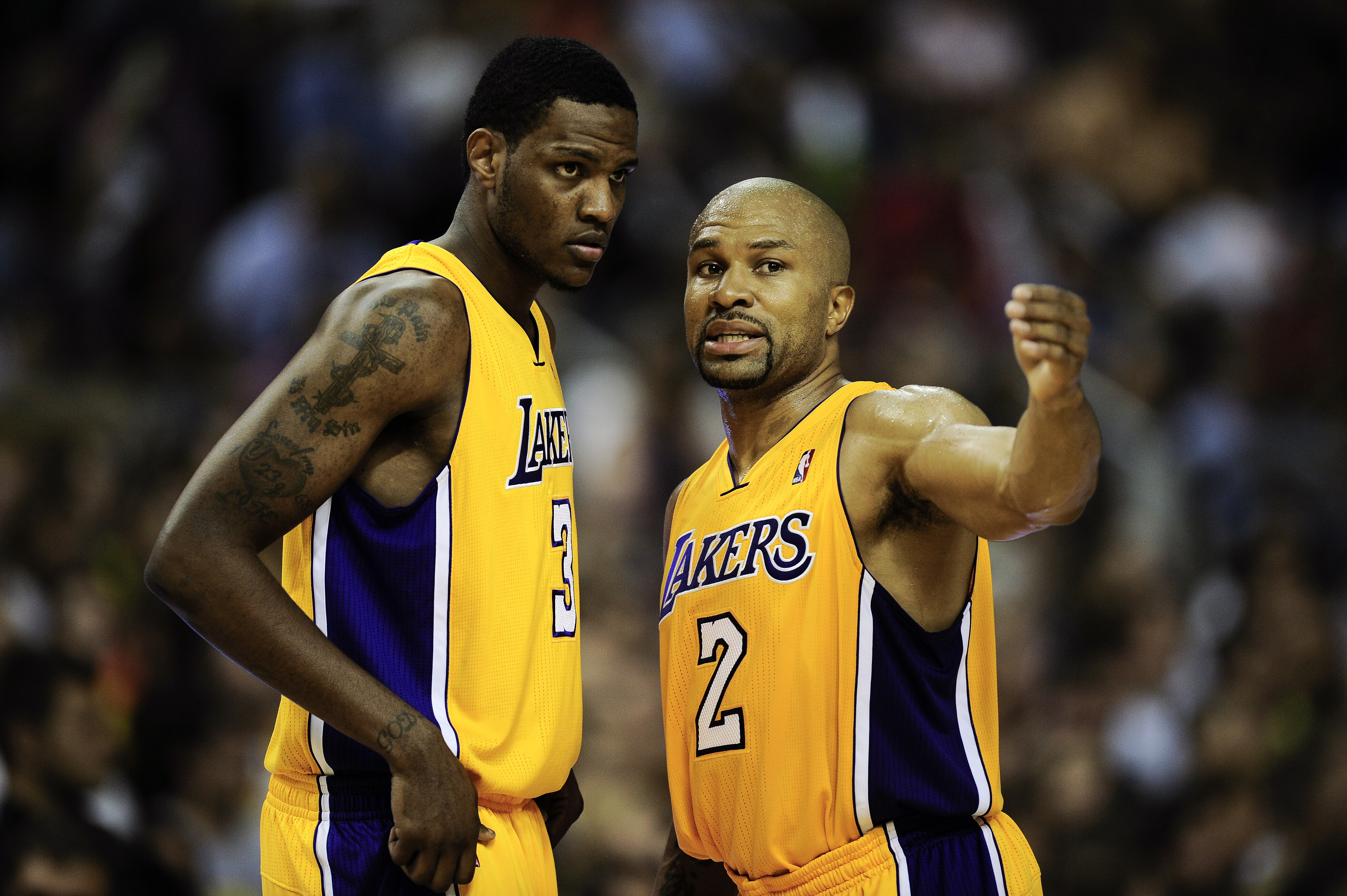 BARCELONA, SPAIN - OCTOBER 07:  Devin Ebanks (L) #3 of the Los Angeles Lakers chats with his teammate Derek Fisher #2 during the NBA Europe Live match between Los Angeles Lakers and Regal FC Barcelona at the at Palau Blaugrana on October 7, 2010 in Barcel