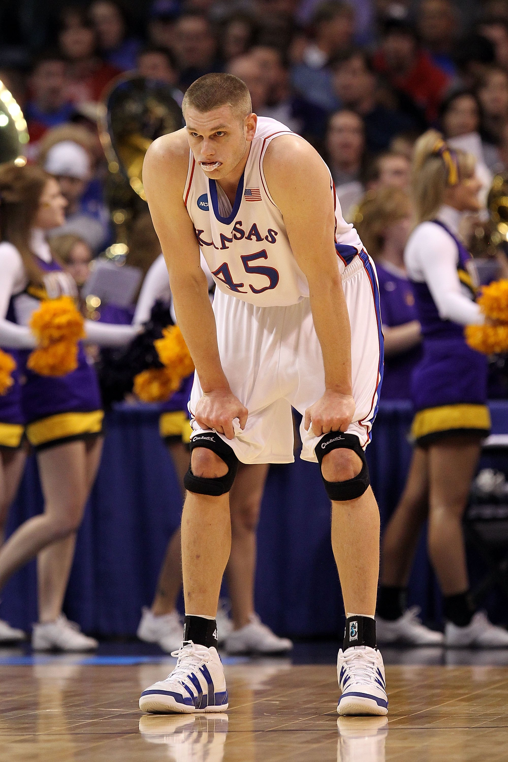 OKLAHOMA CITY - MARCH 20:  Cole Aldrich #45 of the Kansas Jayhawks looks on against the Northern Iowa Panthers during the second round of the 2010 NCAA men's basketball tournament at Ford Center on March 20, 2010 in Oklahoma City, Oklahoma.  (Photo by Ron