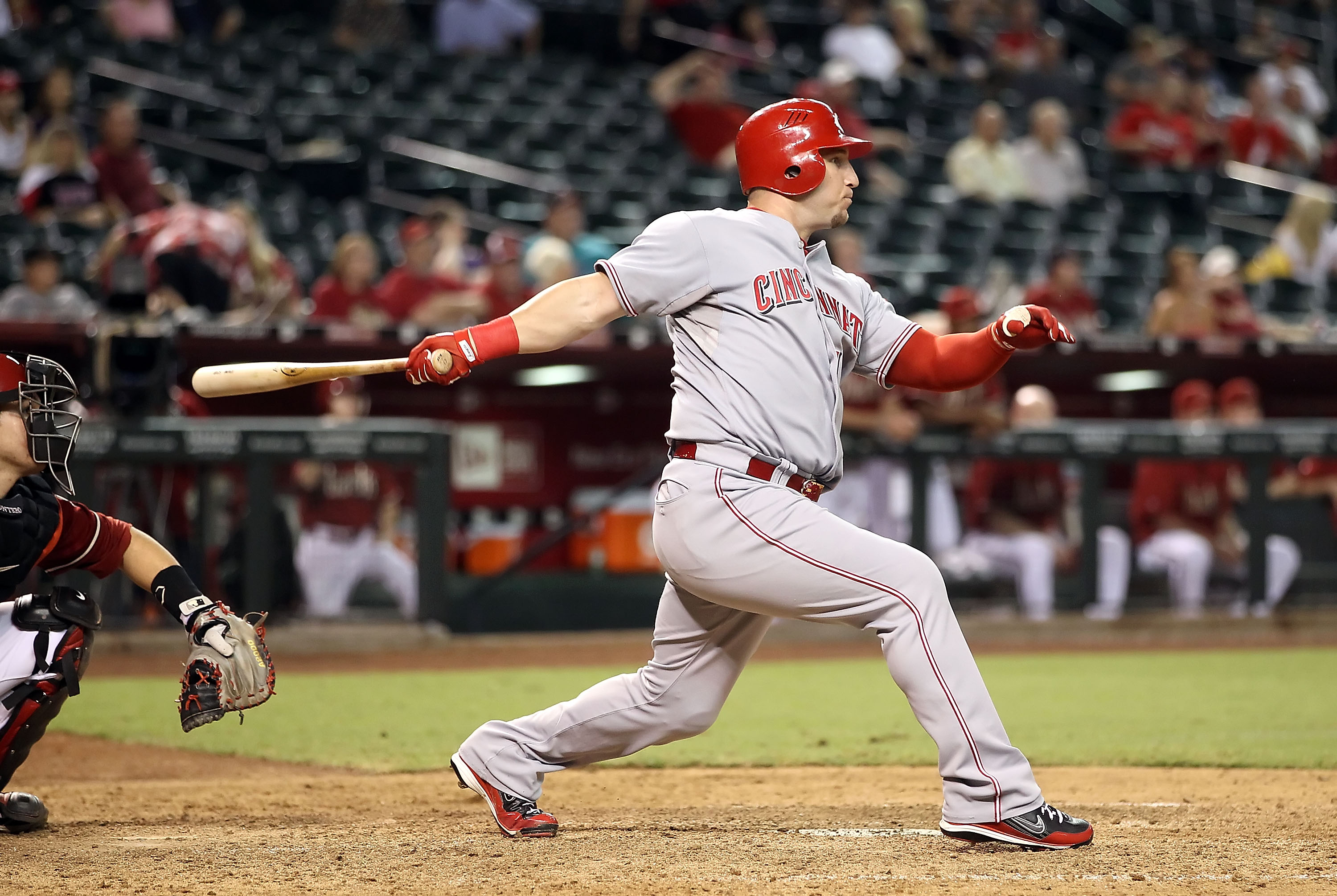 PHOENIX - AUGUST 18:  Laynce Nix #17 of the Cincinnati Reds hits a 2 RBI double against the Arizona Diamondbacks during the ninth inning of the Major League Baseball game at Chase Field on August 18, 2010 in Phoenix, Arizona.  (Photo by Christian Petersen