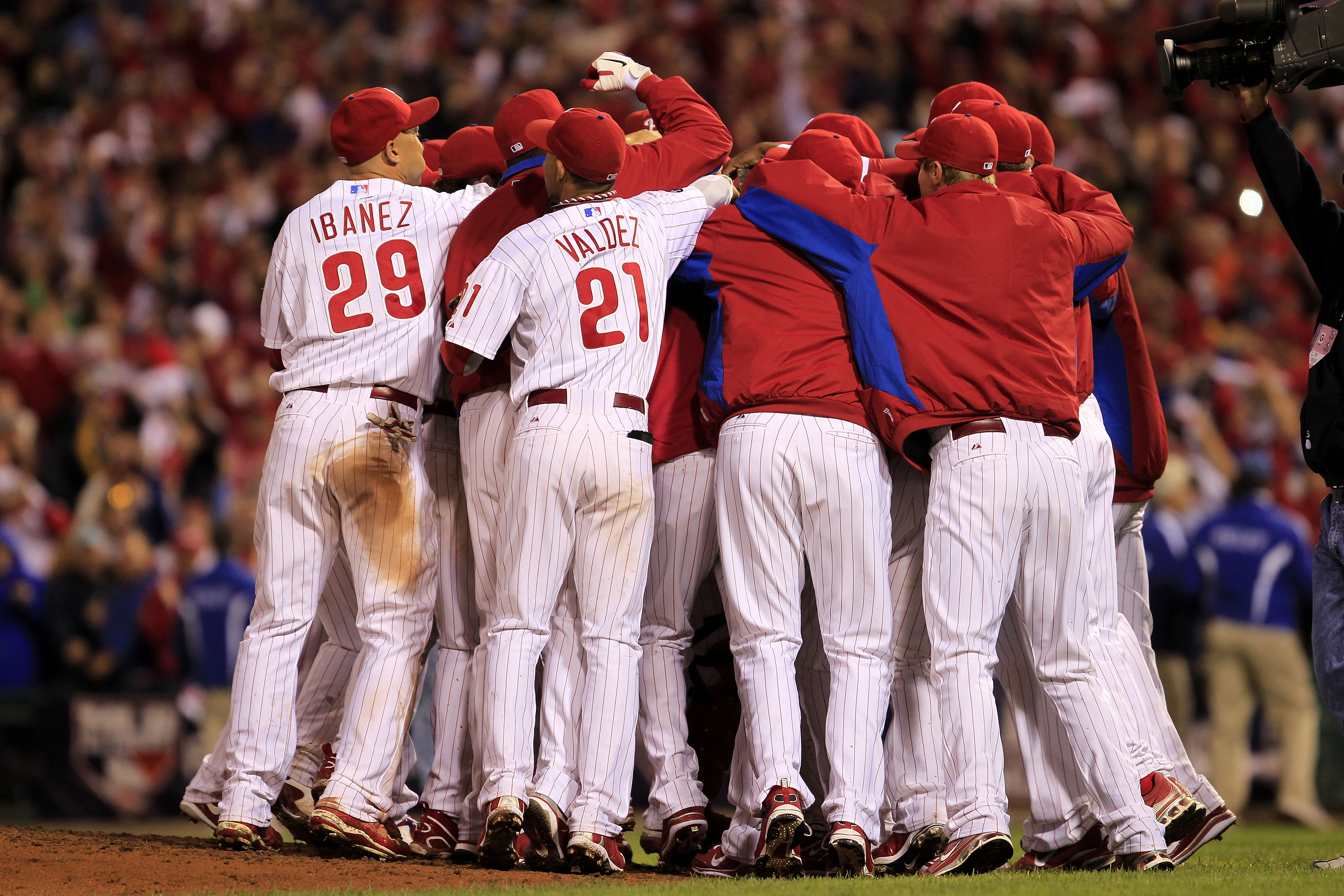 PHILADELPHIA - OCTOBER 06: Roy Halladay #34 of the Philadelphia Phillies is mobbed by teammates after pitching a no-hitter and the win in Game 1 of the NLDS against the Cincinnati Reds at Citizens Bank Park on October 6, 2010 in Philadelphia, Pennsylvania