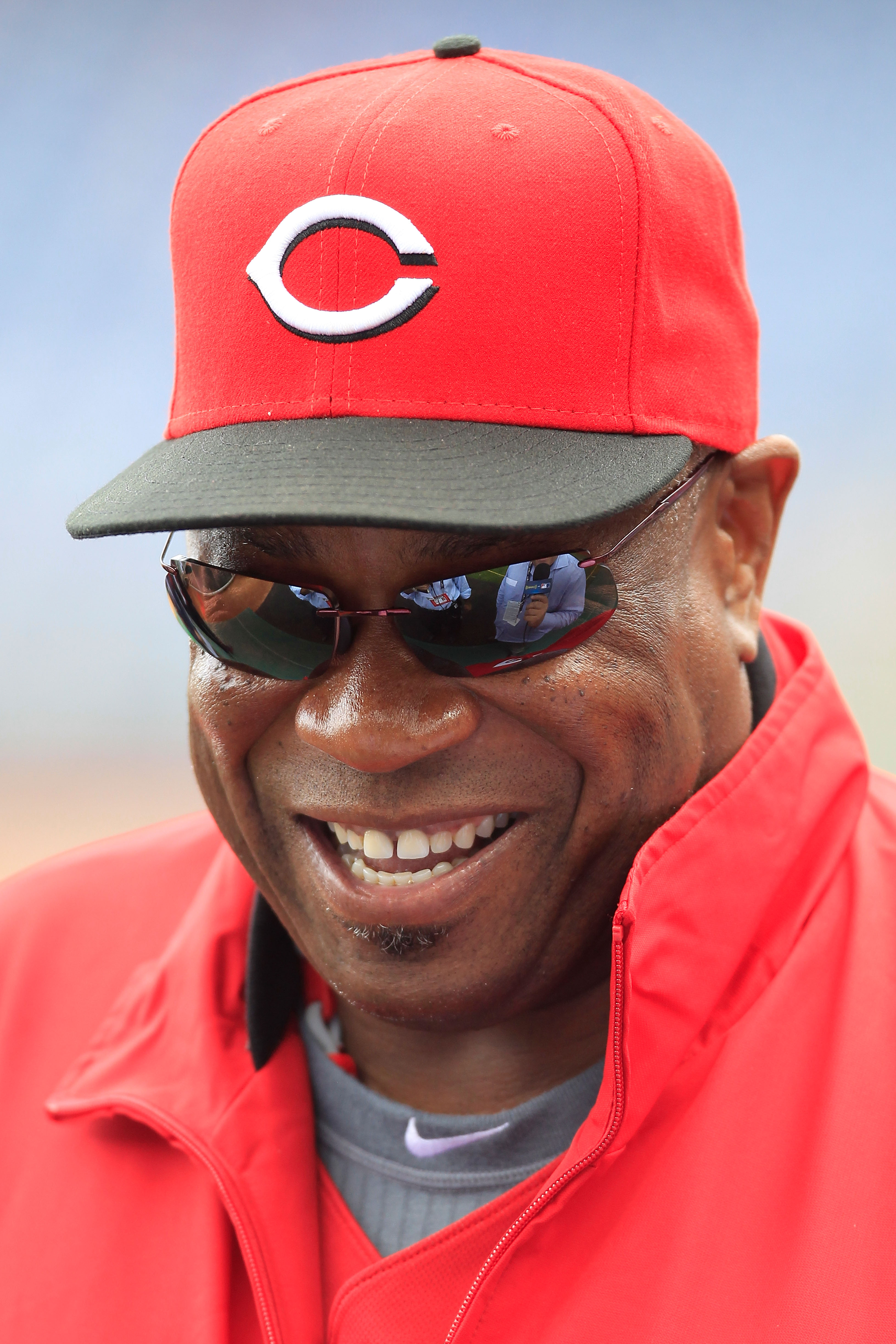 PHILADELPHIA - OCTOBER 06:  Manager Dusty Baker #12 of the Cincinnati Reds watches batting practice before Game 1 of the NLDS against the Philadelphia Phillies at Citizens Bank Park on October 6, 2010 in Philadelphia, Pennsylvania.  (Photo by Chris Trotma