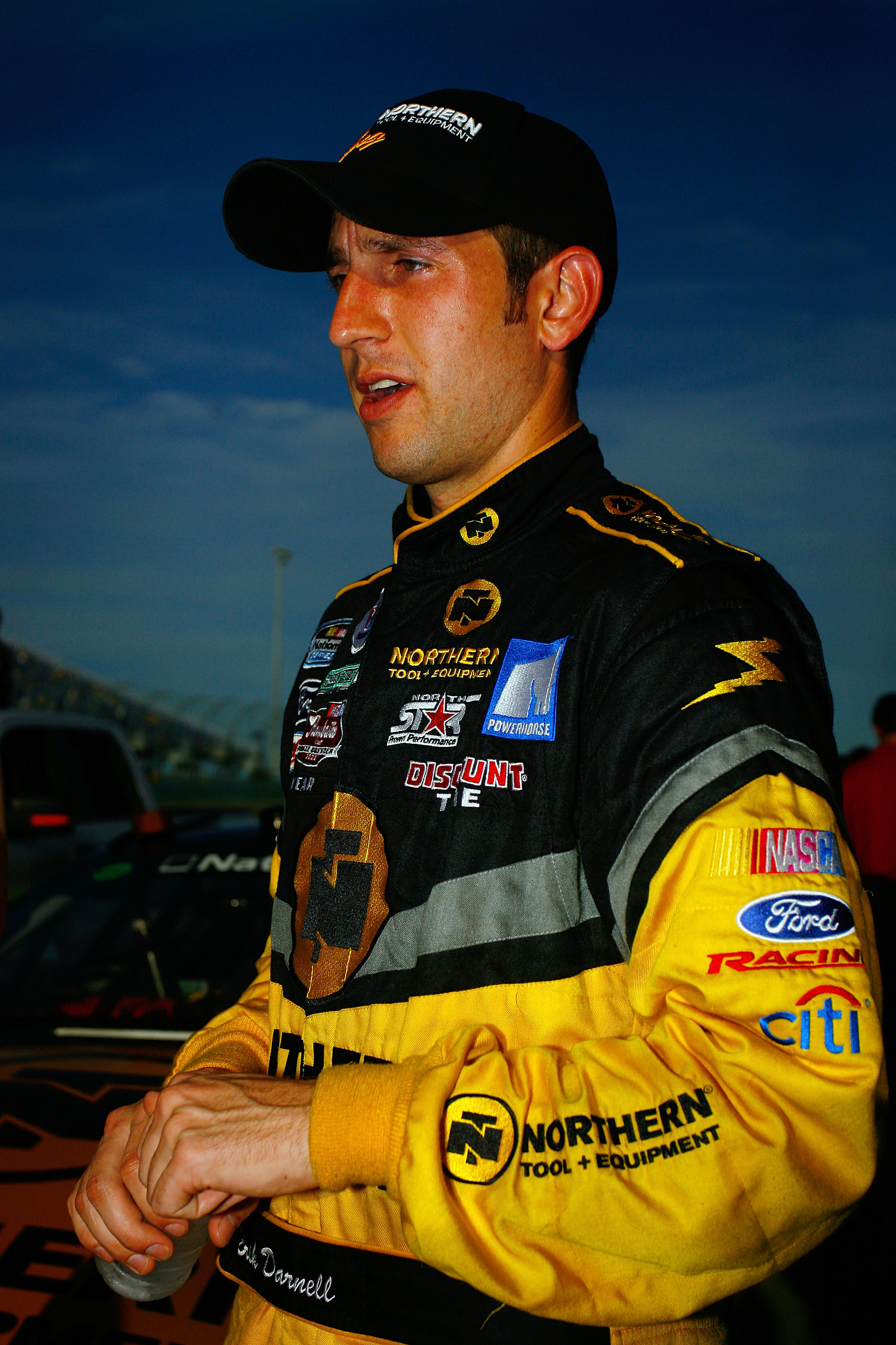 HOMESTEAD, FL - NOVEMBER 21:  Erik Darnell, driver of the #6  Northern Tool + Equipment Ford, stands on the grid prior to the start of the NASCAR Nationwide Series Ford 300 at Homestead-Miami Speedway on November 21, 2009 in Homestead, Florida.  (Photo by
