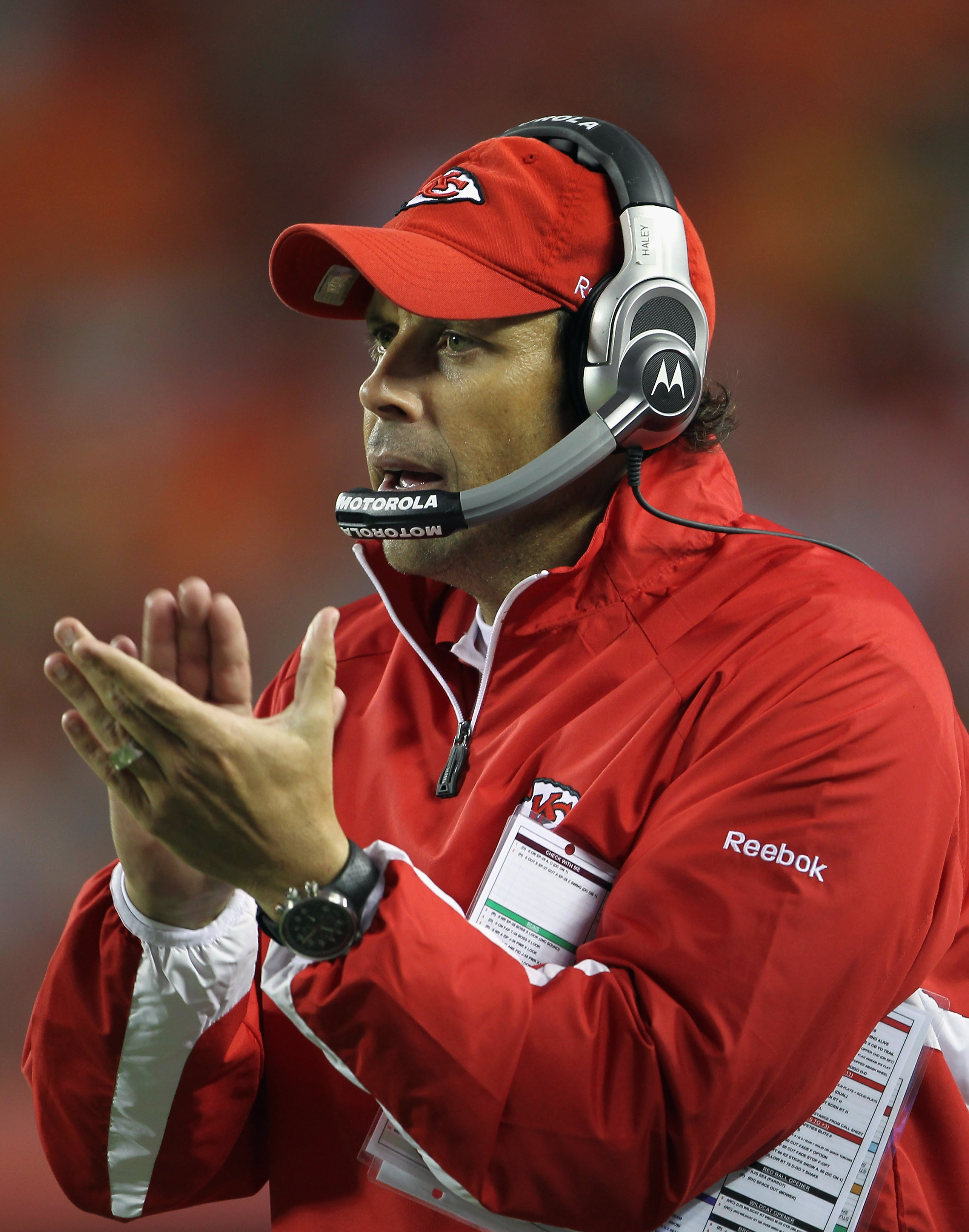 KANSAS CITY, MO - SEPTEMBER 02:  Head coach Todd Haley of the Kansas City Chiefs applaudes players from the sidelines during the game against the Green Bay Packers on September 2, 2010 at Arrowhead Stadium in Kansas City, Missouri.  (Photo by Jamie Squire