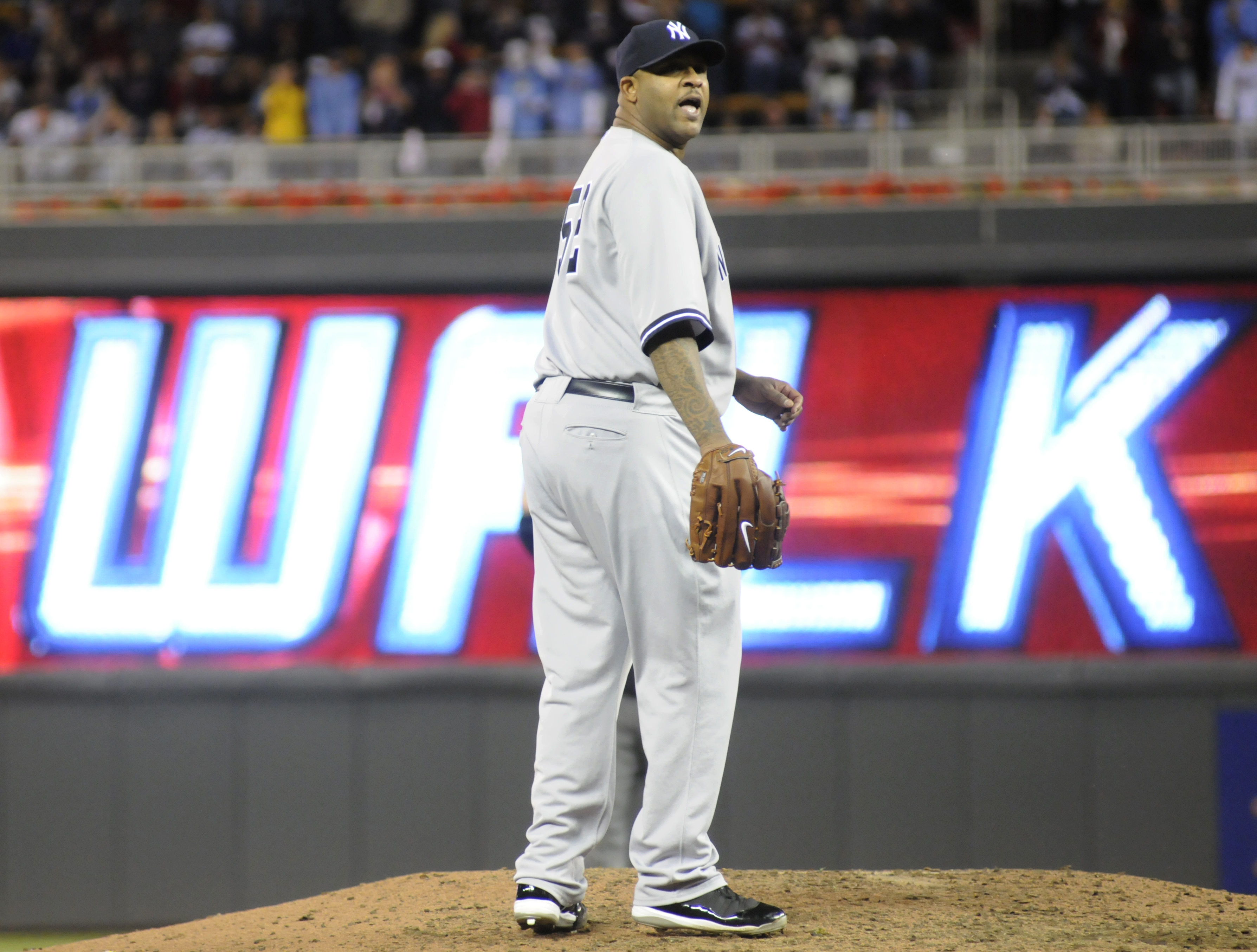 MINNEAPOLIS, MN - OCTOBER 6: CC Sabathia #52 of the New York Yankees reacts to giving up a walk to tie the game in the sixth inning during game one of the ALDS against the Minnesota Twins on October 6, 2010 at Target Field in Minneapolis, Minnesota. (Phot
