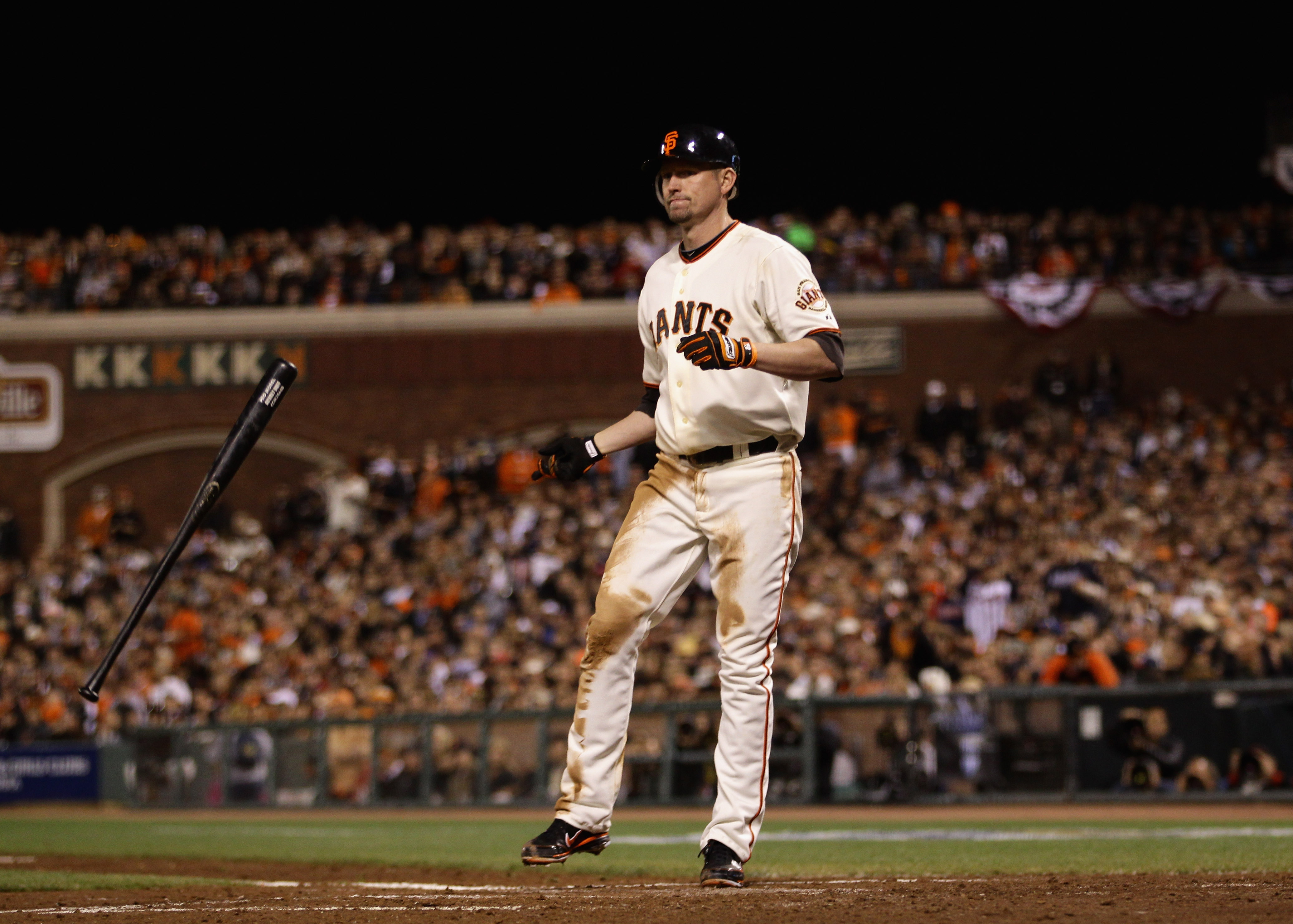 SAN FRANCISCO - OCTOBER 07:  Aubrey Huff #17 of the San Francisco Giants tosses his bat after he struck out with runners on second and third base to end the third inning of their game against the Atlanta Braves in game 1 of the NLDS at AT&T Park on Octobe