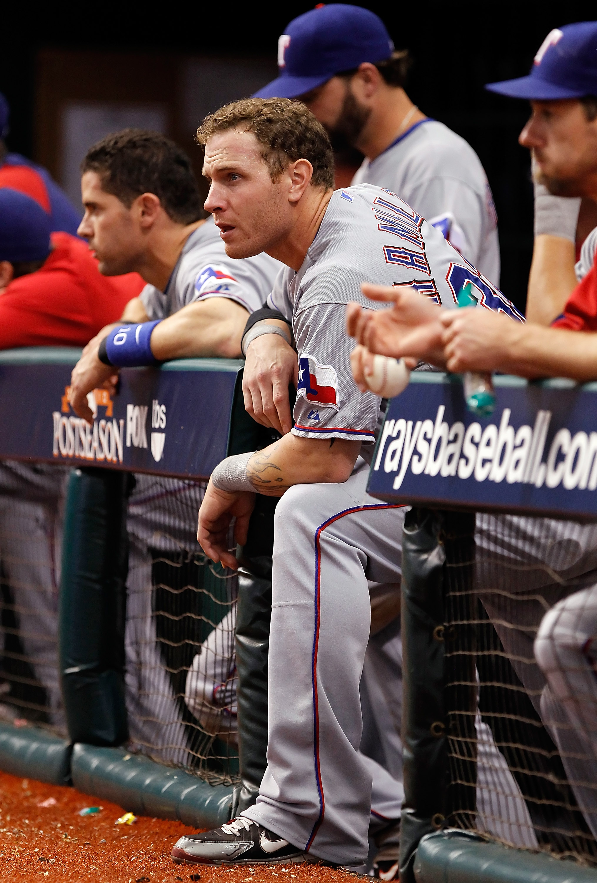 ST PETERSBURG, FL - OCTOBER 07:  Outfielder Josh Hamilton #32 of the Texas Rangers watches his team from the dugout against the Tampa Bay Rays during Game 2 of the ALDS at Tropicana Field on October 7, 2010 in St. Petersburg, Florida.  (Photo by J. Meric/