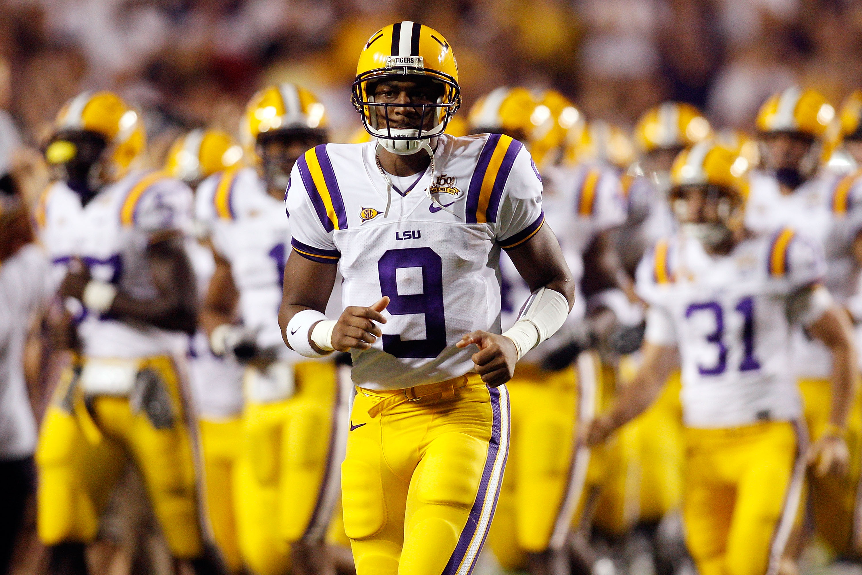 BATON ROUGE, LA - SEPTEMBER 25:  Jordan Jefferson #9 of the Louisiana State Univeristy Tigers runs on the field before playing the West Virginia Mountaineers at Tiger Stadium on September 25, 2010 in Baton Rouge, Louisiana.  (Photo by Chris Graythen/Getty
