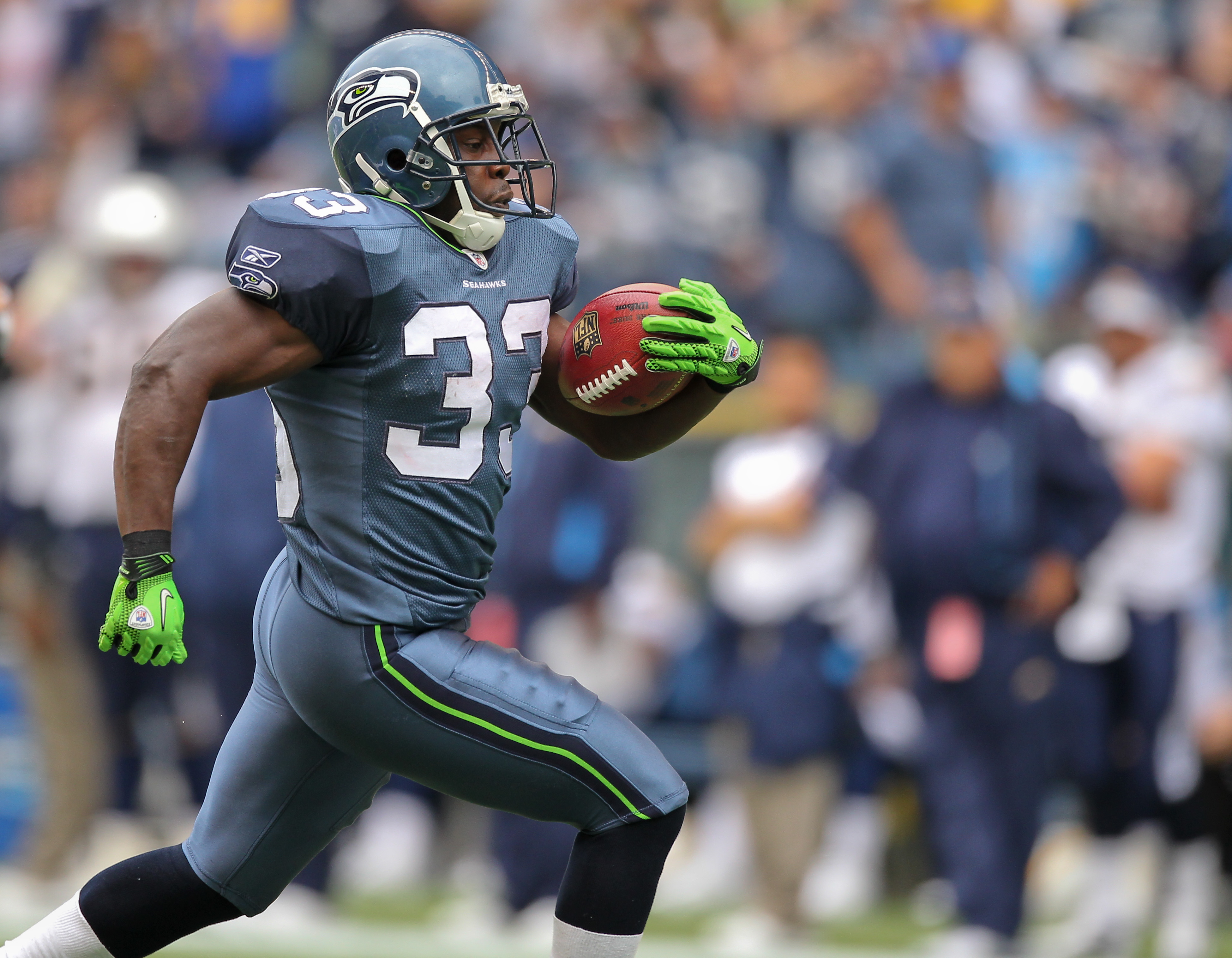 SEATTLE - SEPTEMBER 26:  Kick returner Leon Washington #33 of the Seattle Seahawks rushes 101 yards on a kickoff return for a touchdown at the start of the third quarter against the San Diego Chargers at Qwest Field on September 26, 2010 in Seattle, Washi