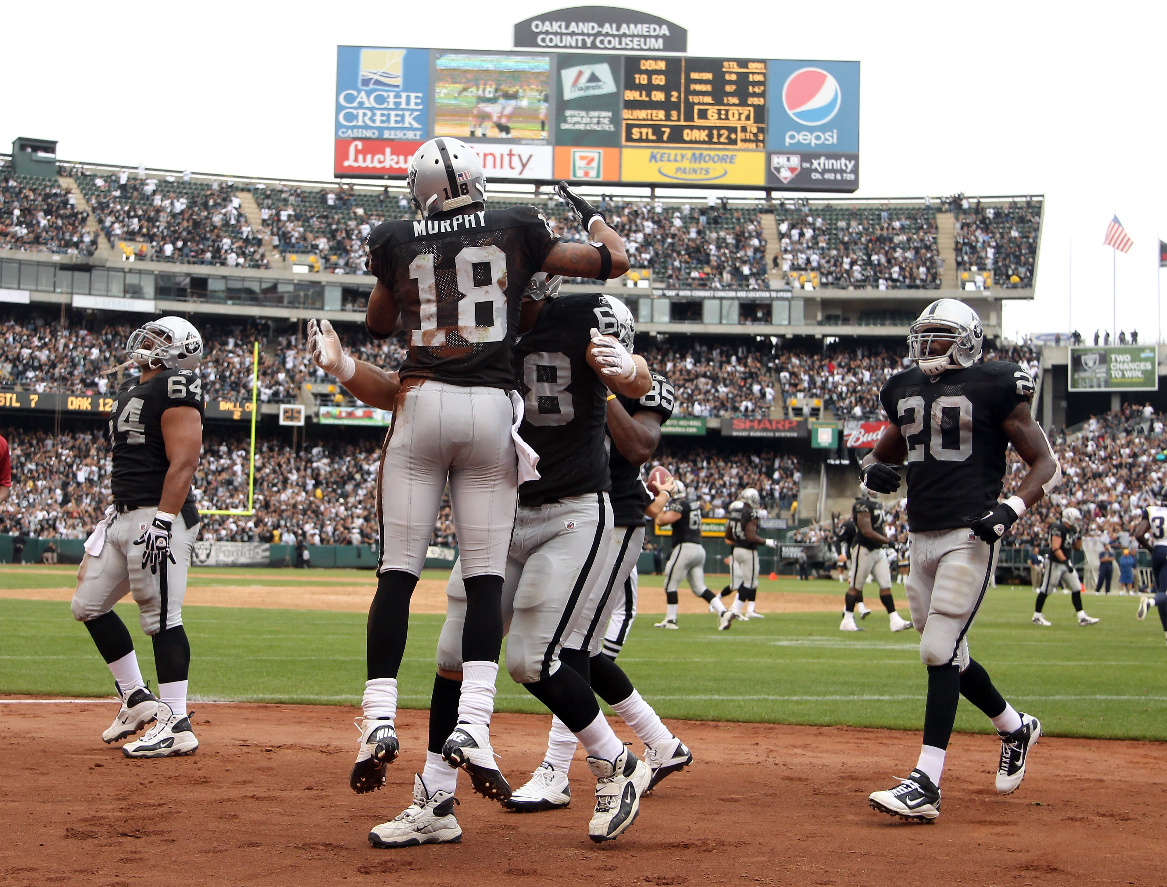 OAKLAND, CA - SEPTEMBER 19:  Louis Murphy #18 of the Oakland Raiders is congratulated by teammates after he scored a touchdown during their game against the St. Louis Rams at the Oakland-Alameda County Coliseum on September 19, 2010 in Oakland, California