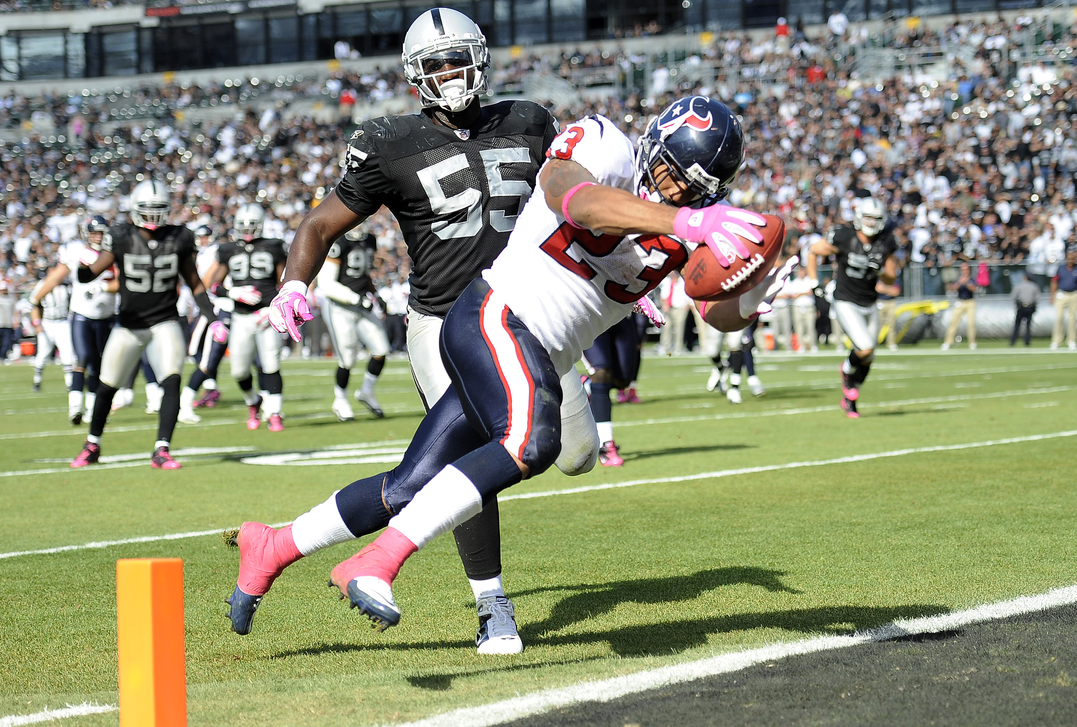 OAKLAND, CA - OCTOBER 3:  Running back Arian Foster #23 of the Houston Texans scores a touchdown in front of linebacker Rolando McClain #55 of the Oakland Raiders  during an NFL football game October 3, 2010 at The Oakland-Alameda County Coliseum in Oakla