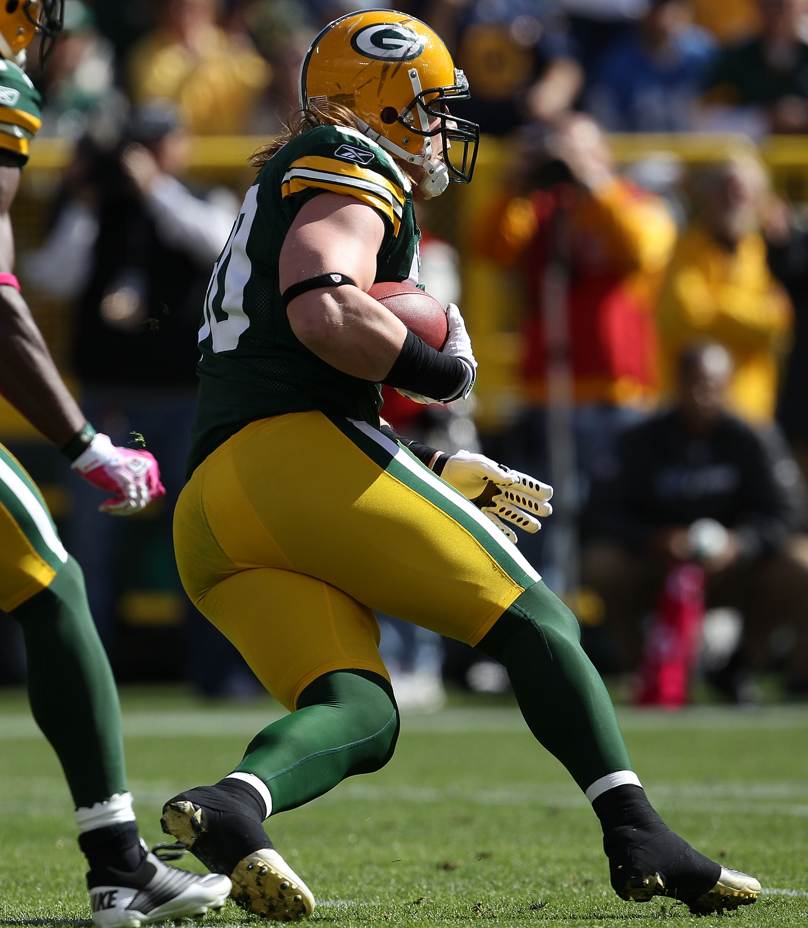GREEN BAY, WI - OCTOBER 03: A.J. Hawk #50 of the Green Bay Packers runs after intercepting a pass against the Detroit Lions at Lambeau Field on October 3, 2010 in Green Bay, Wisconsin. The Packers defeated the Lions 28-26. (Photo by Jonathan Daniel/Getty