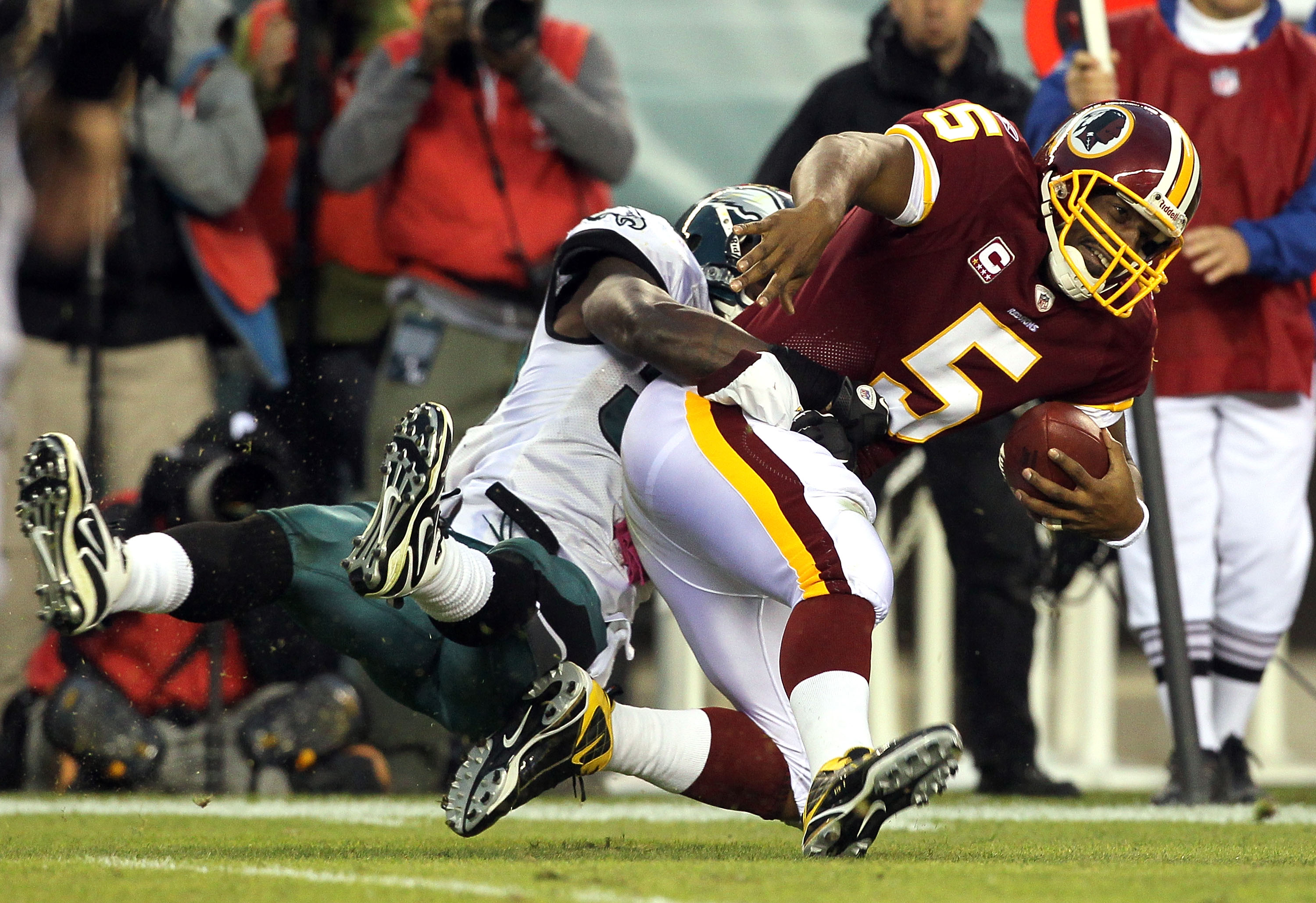 PHILADELPHIA - OCTOBER 03:  Donovan McNabb #5 of the Washington Redskins is sacked by Ernie Sims #50 of the Philadelphia Eagles on October 3, 2010 at Lincoln Financial Field in Philadelphia, Pennsylvania. The Redskins defeated the Eagles 17-12.  (Photo by