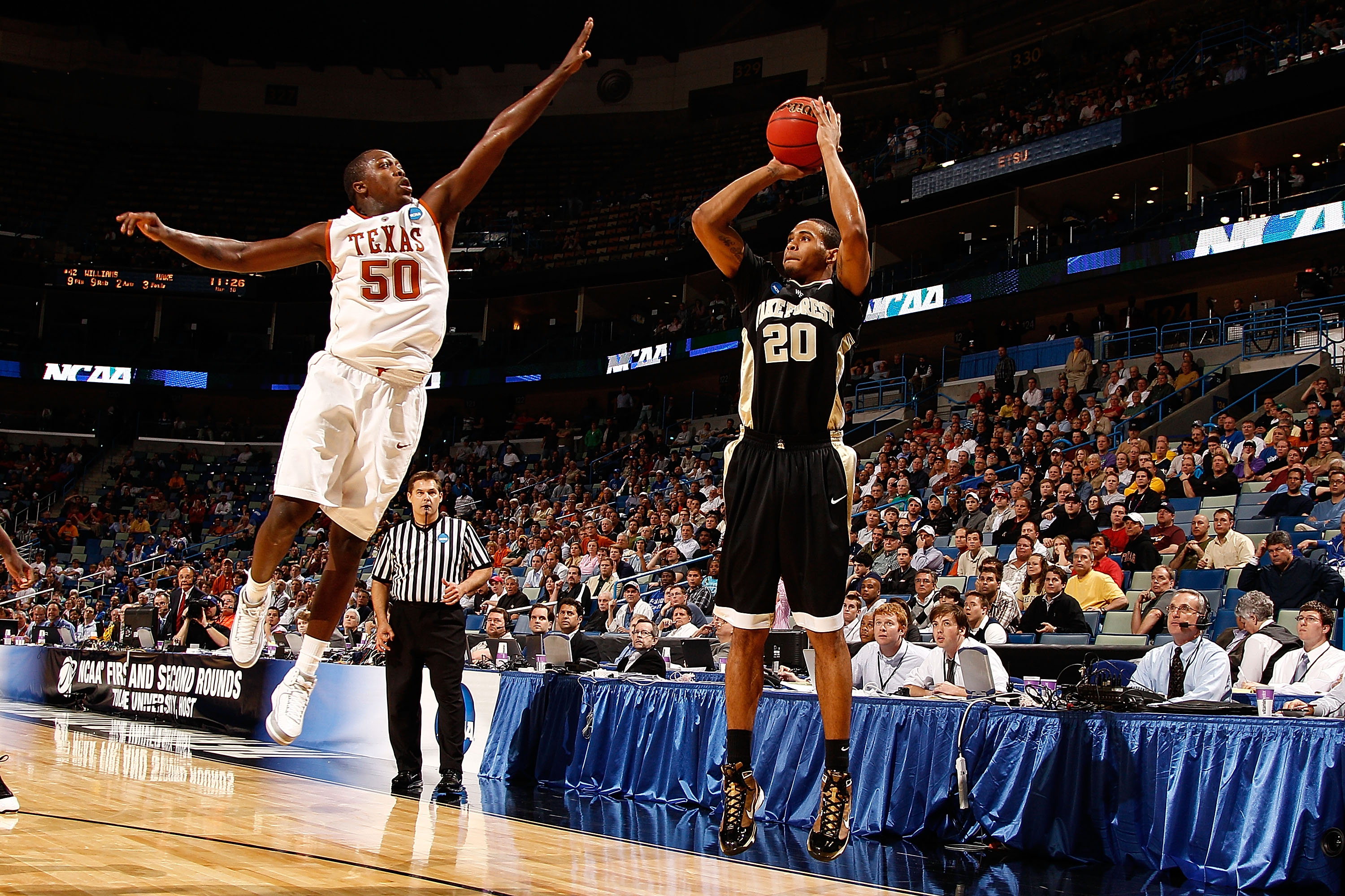 NEW ORLEANS - MARCH 18:  Ari Stewart #20 of the Wake Forest Demon Deacons makes a shot over J'Covan Brown #50 of the Texas Longhorns 81-80 in overtime during the first round of the 2010 NCAA men�s basketball tournament at the New Orleans Arena on March 18