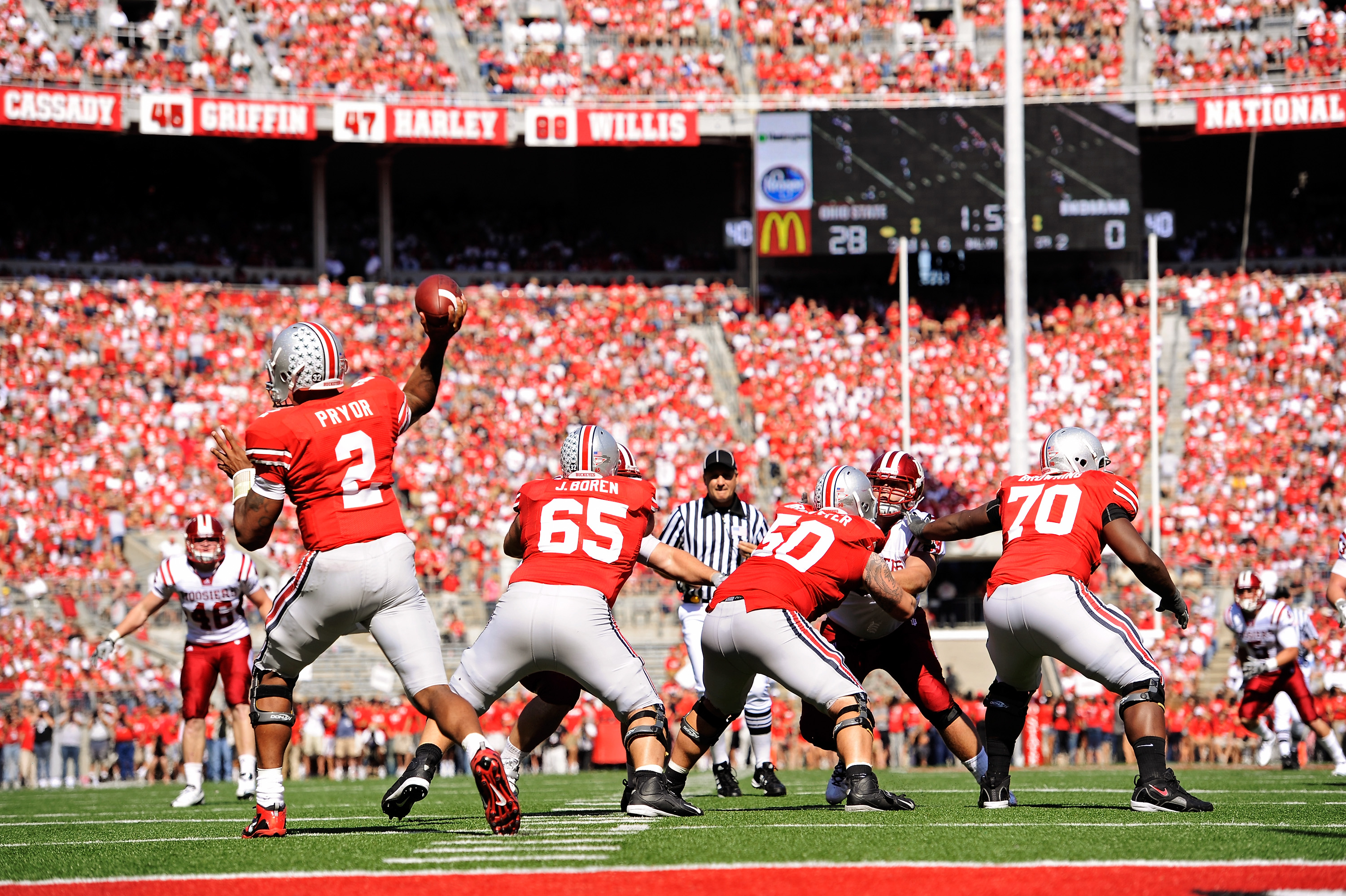 COLUMBUS, OH - OCTOBER 9:  Quarterback Terrelle Pryor #2 of the Ohio State Buckeyes makes a pass as his offensive line holds back the Indiana Hoosiers at Ohio Stadium on October 9, 2010 in Columbus, Ohio. Ohio State defeated Indiana 38-10.   (Photo by Jam