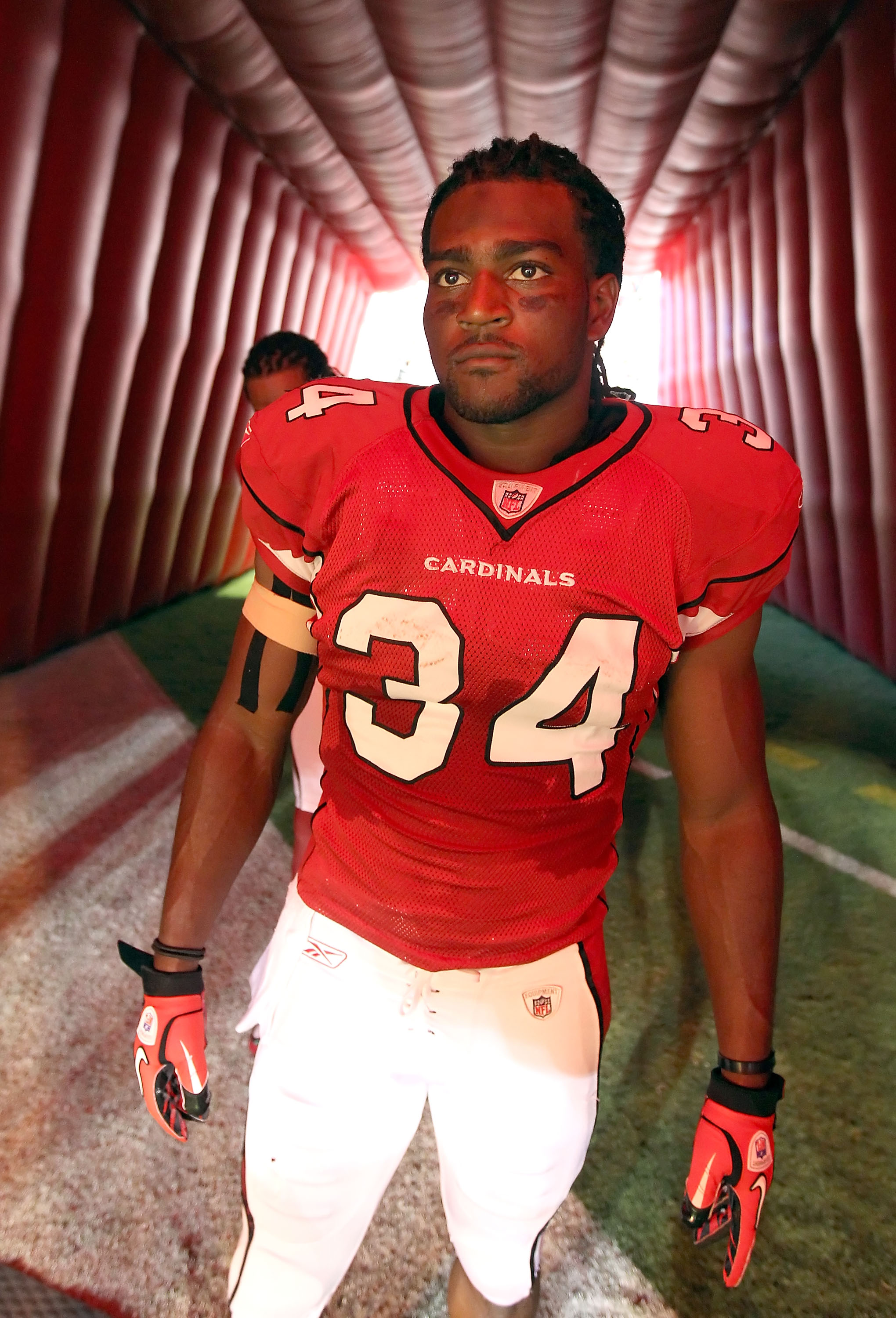 GLENDALE, AZ - SEPTEMBER 26:  Runningback Tim Hightower #34 of the Arizona Cardinals waits to be introduced before the NFL game against the Oakland Raiders at the University of Phoenix Stadium on September 26, 2010 in Glendale, Arizona.  The Cardinals def