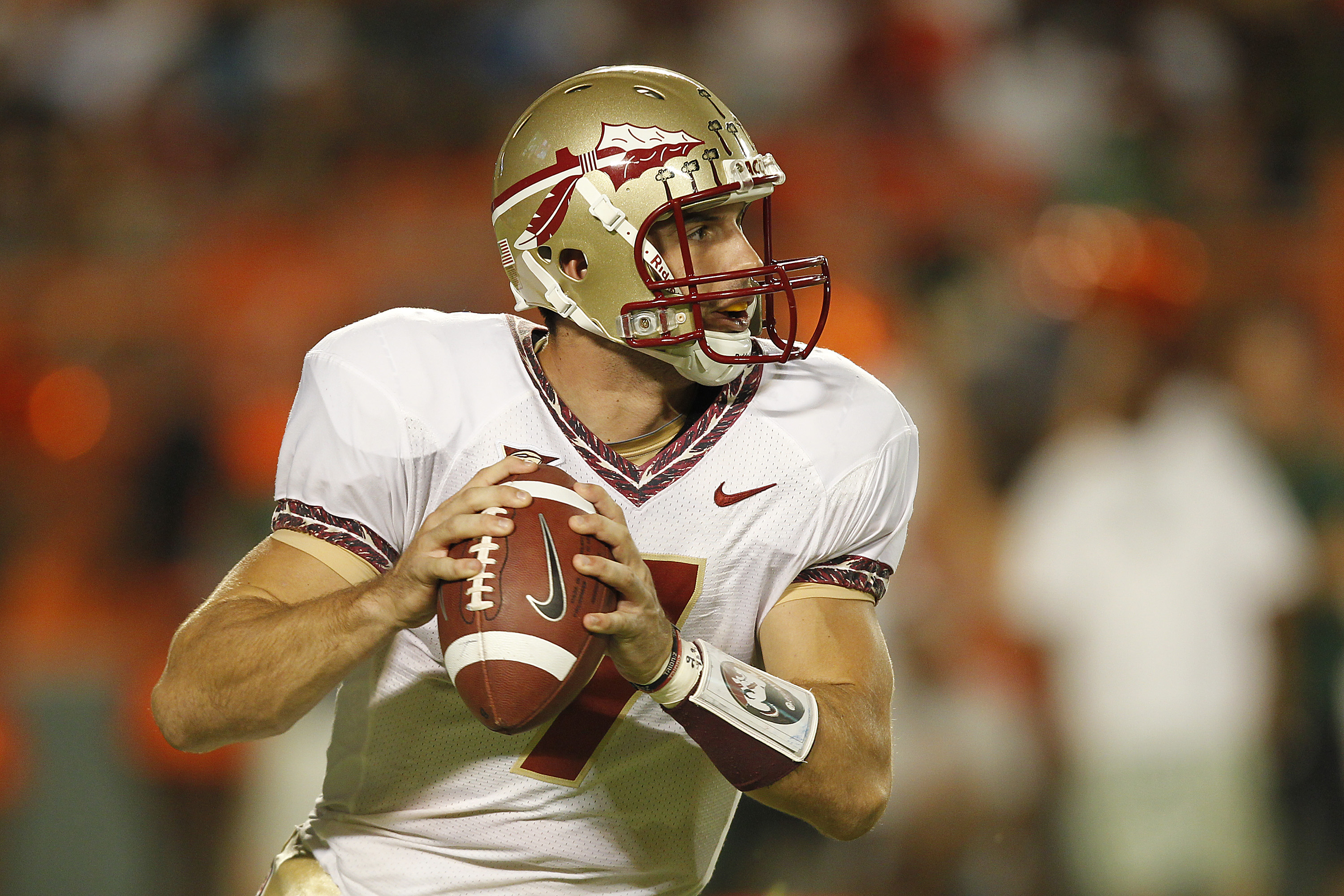 MIAMI, FL - OCTOBER 9: Christian Ponder #7 of the Florida State Seminoles runs out of the pocket to pass the ball against the Miami Hurricanes on October 9, 2010 at Sun Life Stadium in Miami, Florida. (Photo by Joel Auerbach/Getty Images)