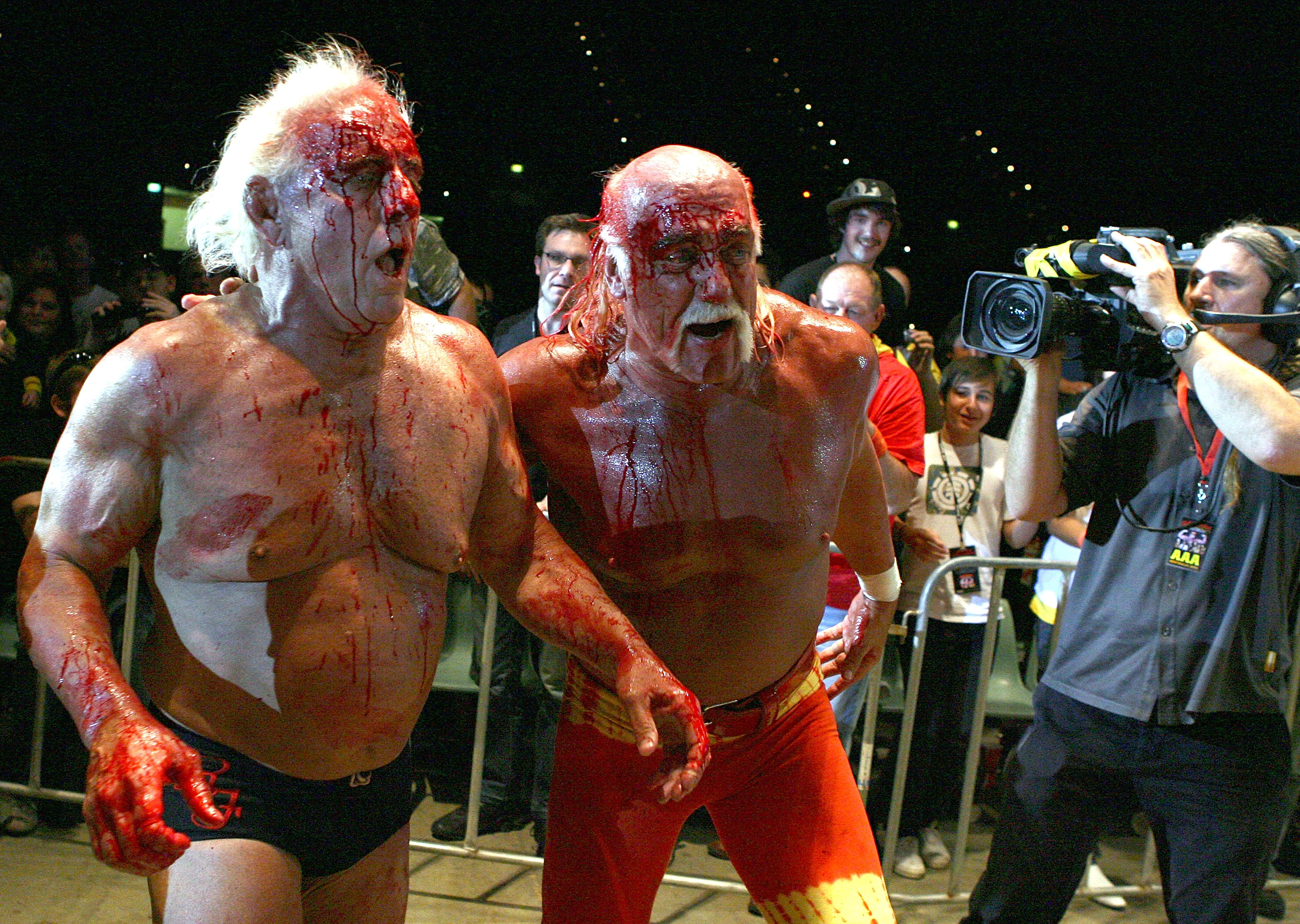 PERTH, AUSTRALIA - NOVEMBER 24:  Hulk Hogan guides Rick Flair back to the ring during the Hulkamania Tour at the Burswood Dome on November 24, 2009 in Perth, Australia.  (Photo by Paul Kane/Getty Images)