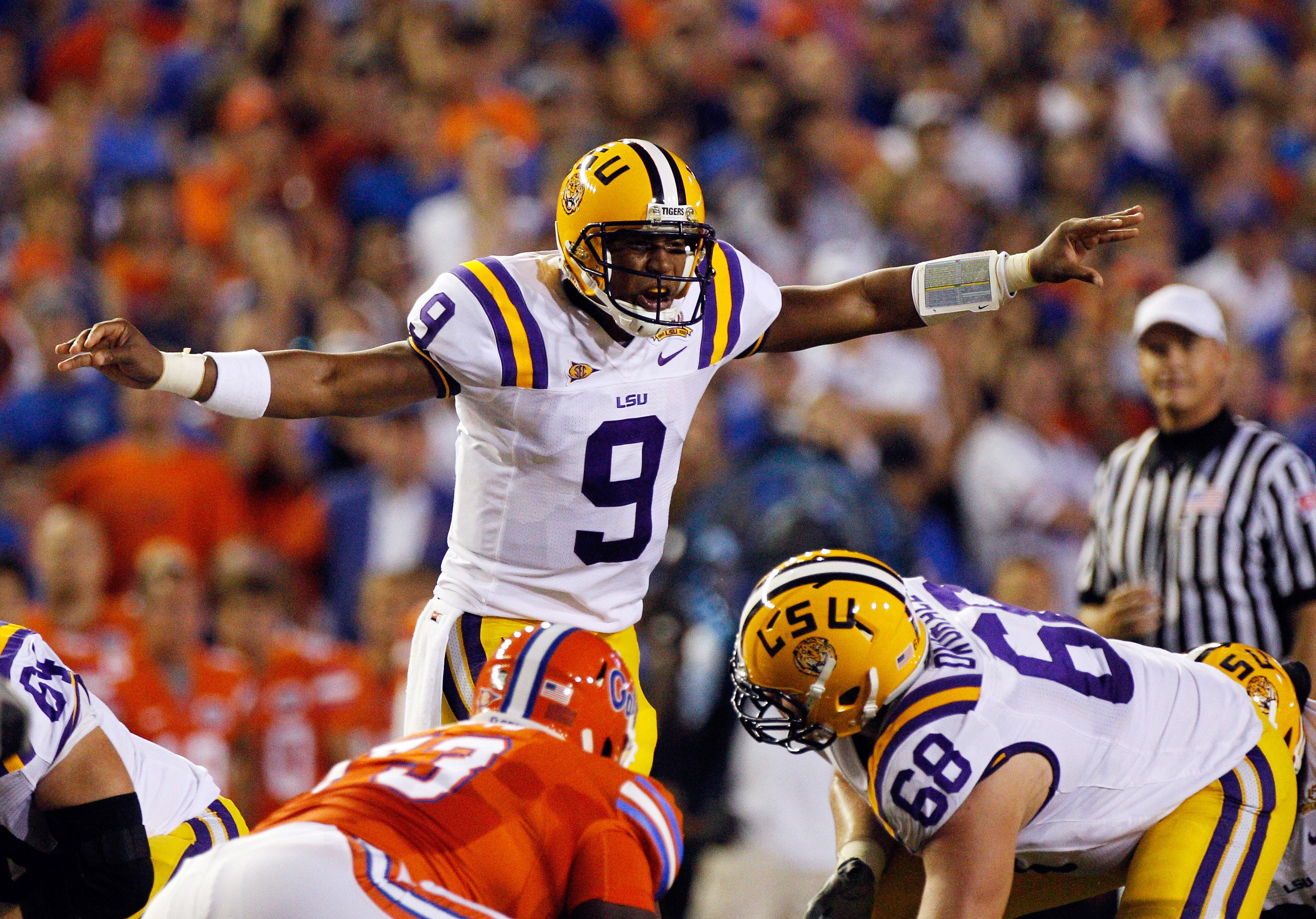 GAINESVILLE, FL - OCTOBER 09:  Quarterback Jordan Jefferson #9 of the Louisiana State University Tigers calls a signal during the game against the Florida Gators at Ben Hill Griffin Stadium on October 9, 2010 in Gainesville, Florida.  (Photo by Sam Greenw