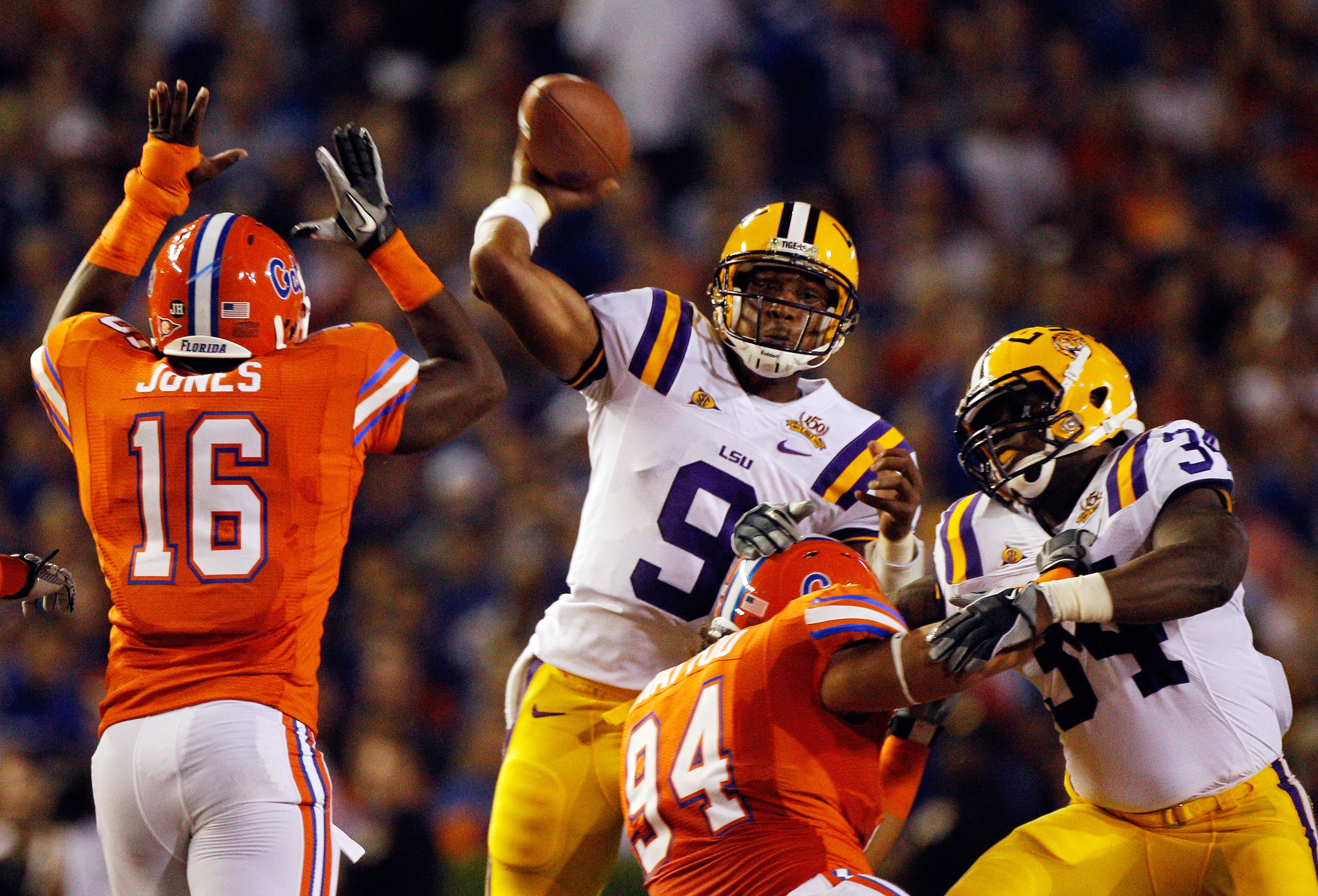 GAINESVILLE, FL - OCTOBER 09:  Quarterback Jordan Jefferson #9 of the Louisiana State University Tigers attempts a pass over A.J. Jones #16 of the Florida Gators during the game at Ben Hill Griffin Stadium on October 9, 2010 in Gainesville, Florida.  (Pho