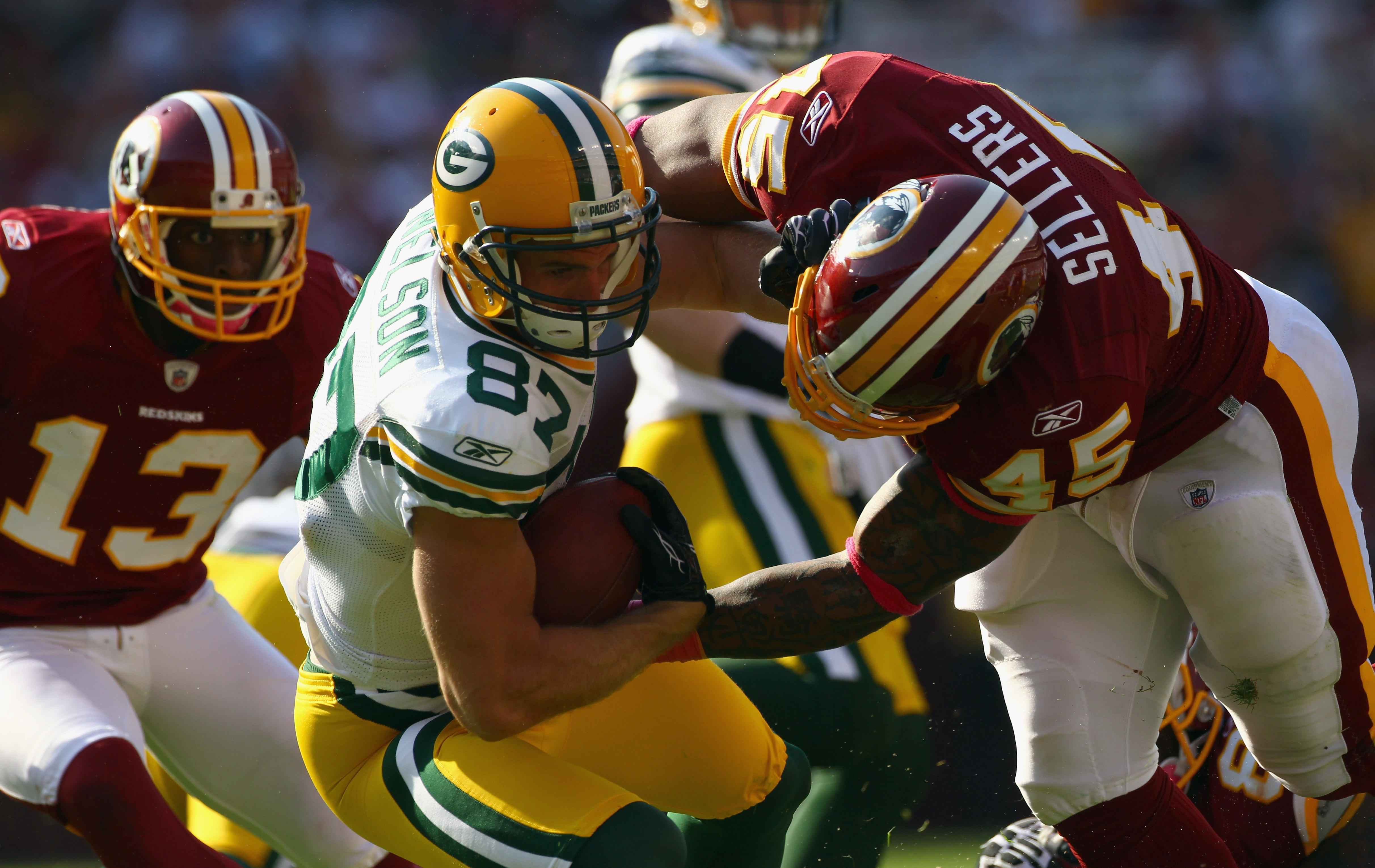 LANDOVER, MD - OCTOBER 10:  Wide receiver Jordy Nelson #87 of the Green Bay Packers is tackled by Mike Sellers #45 of the Washington Redskins on a punt return at FedExField on October 10, 2010 in Landover, Maryland. The Redskins won the game in overtime 1