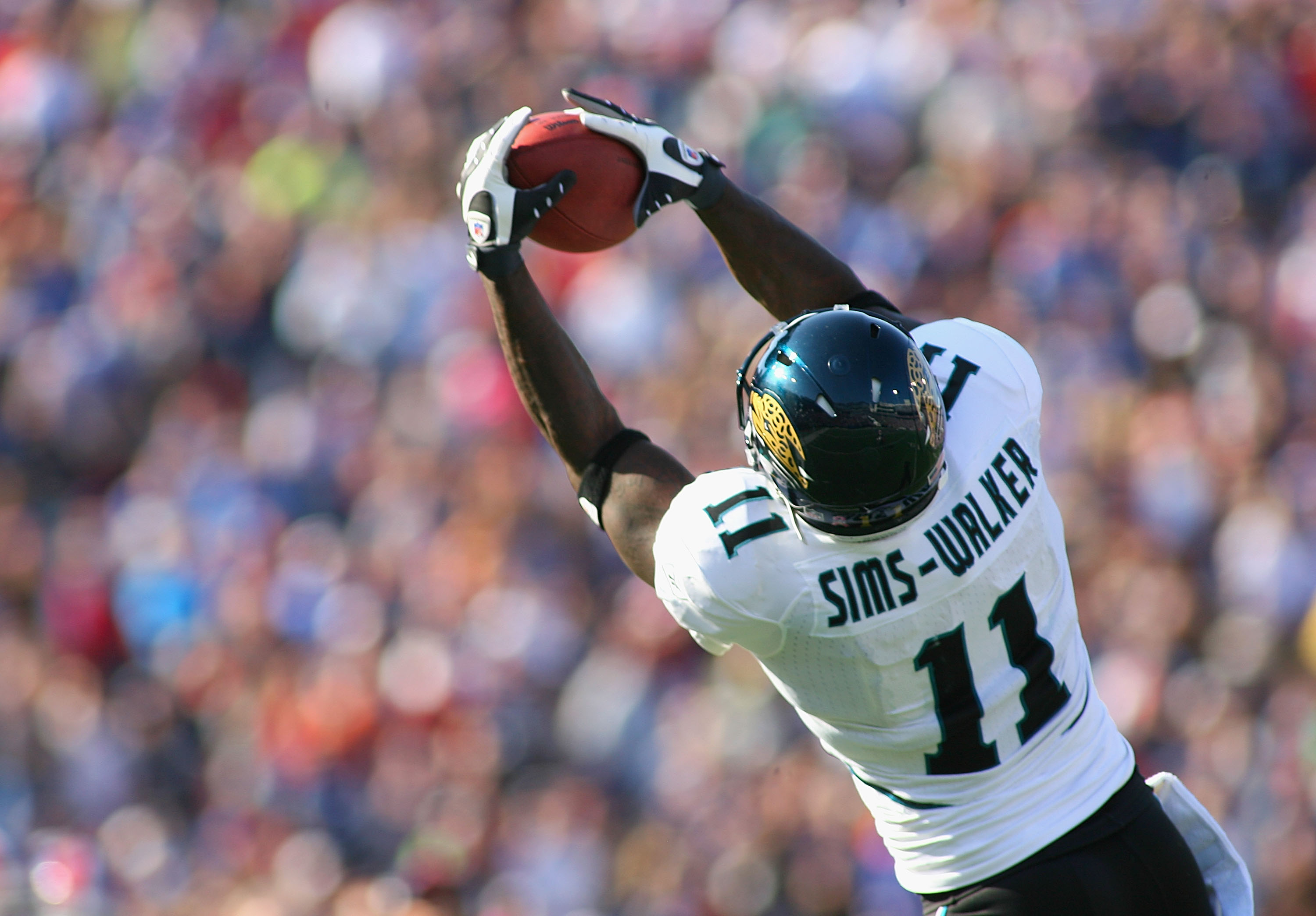 ORCHARD PARK, NY - OCTOBER 10:  Mike Sims-Walker #11 of the Jacksonville Jaguars makes a catch against the Buffalo Bills   at Ralph Wilson Stadium on October 10, 2010 in Orchard Park, New York. Jacksonville won 36-26. (Photo by Rick Stewart/Getty Images)