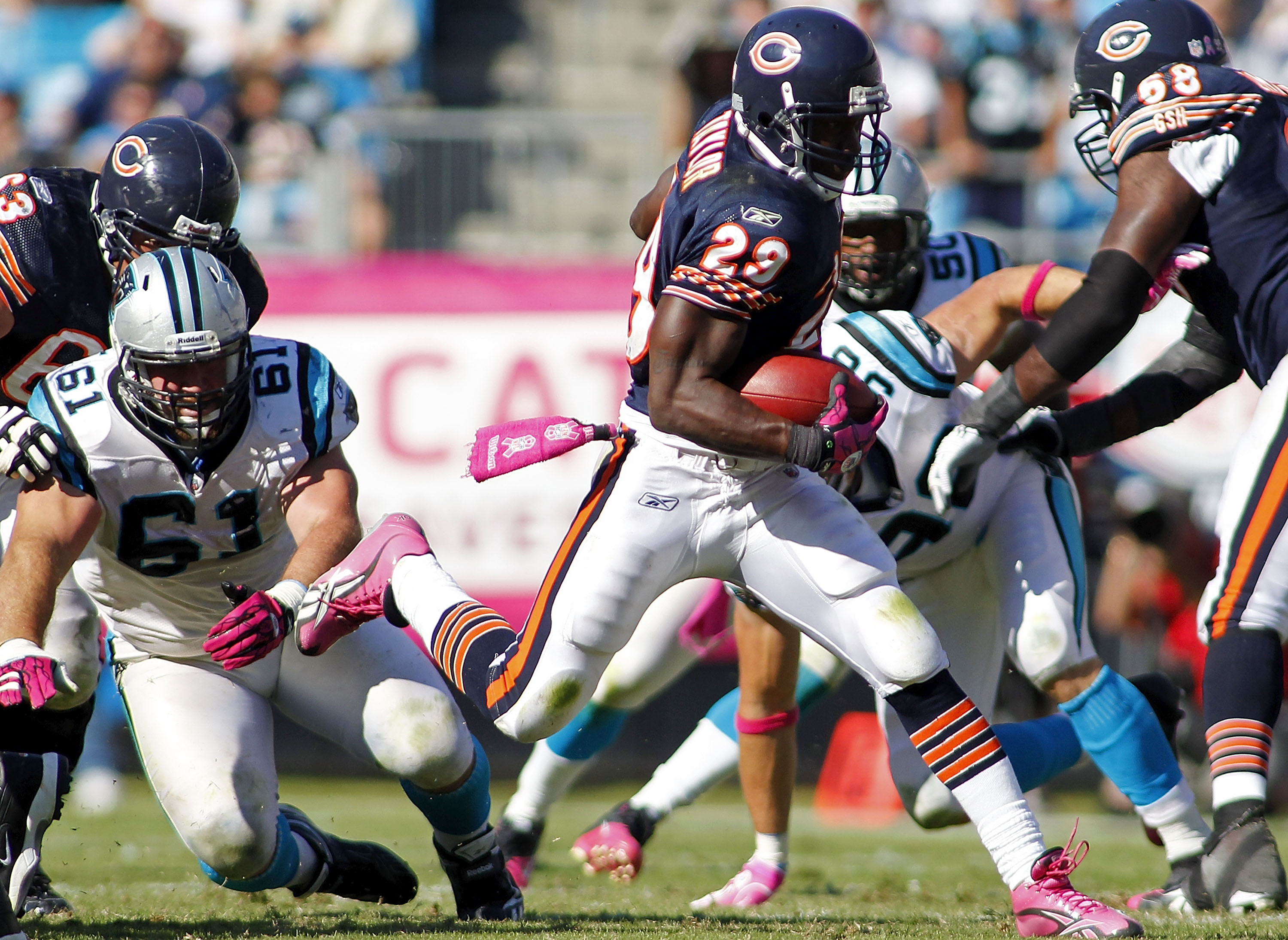 CHARLOTTE, NC - OCTOBER 10: Running back Chester Taylor #29 of the Chicago Bears runs with the ball past defensive tackle Derek Landri #61 of the Carolina Panthers at Bank of America Stadium on October 10, 2010 in Charlotte, North Carolina.  (Photo by Geo