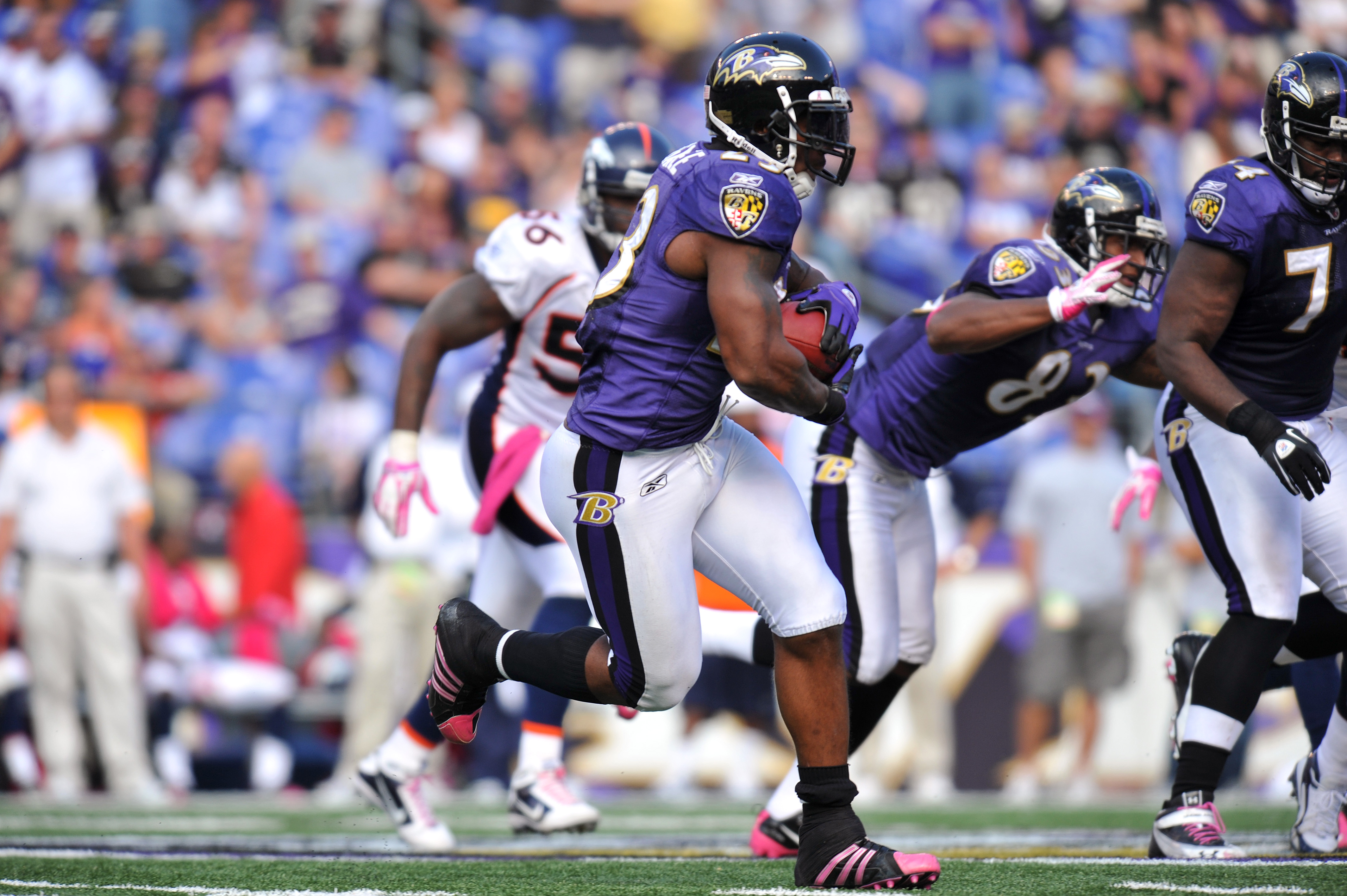 BALTIMORE, MD - OCTOBER 10:  Willis McGahee #23 of the Baltimore Ravens runs the ball against the Denver Broncos at M&T Bank Stadium on October 10, 2010 in Baltimore, Maryland. Players wore pink in recognition of Breast Cancer Awareness Month. The Ravens